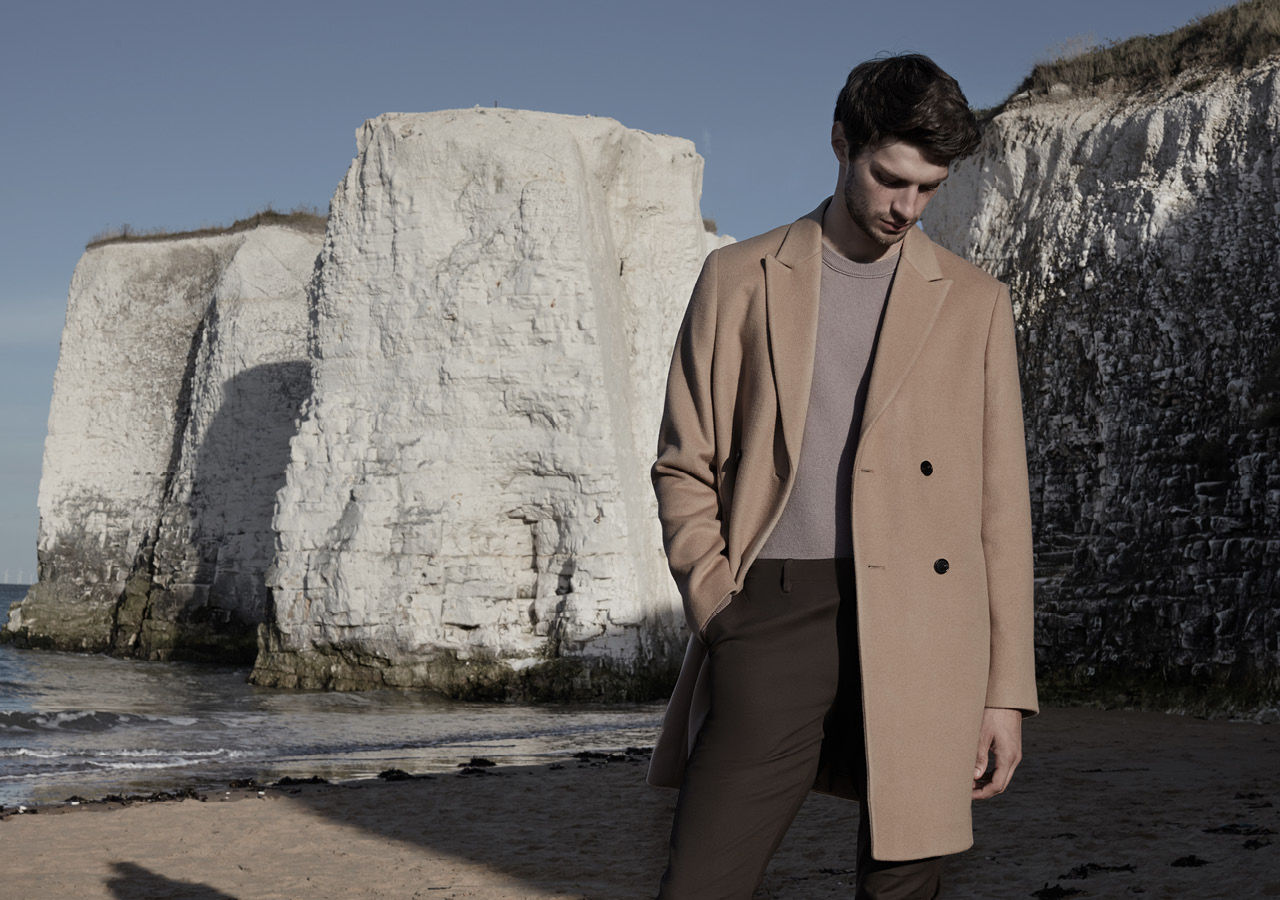 Mapel double-breasted coat , £325  Hamilton cashmere crew-neck jumper , £175  Westbury slim-fit chinos , £95  Tenor leather Chelsea boots , £195