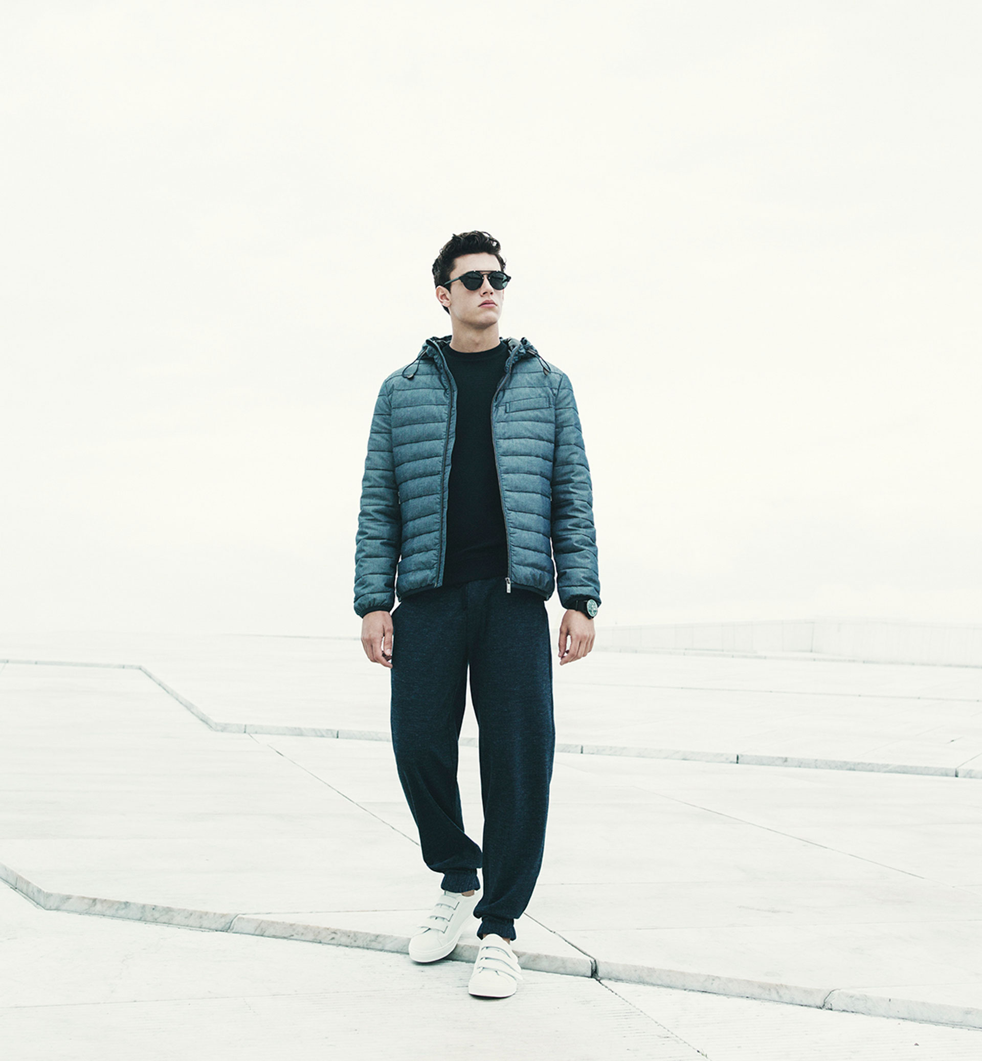 Soft indigo quilted feather down jacket , £109  Soft textured sweatshirt , £54.95  Soft herringbone jogging trousers , £54.95  Soft white leather sneakers with straps , £74.95  Soft polarised sunglasses , £64.95
