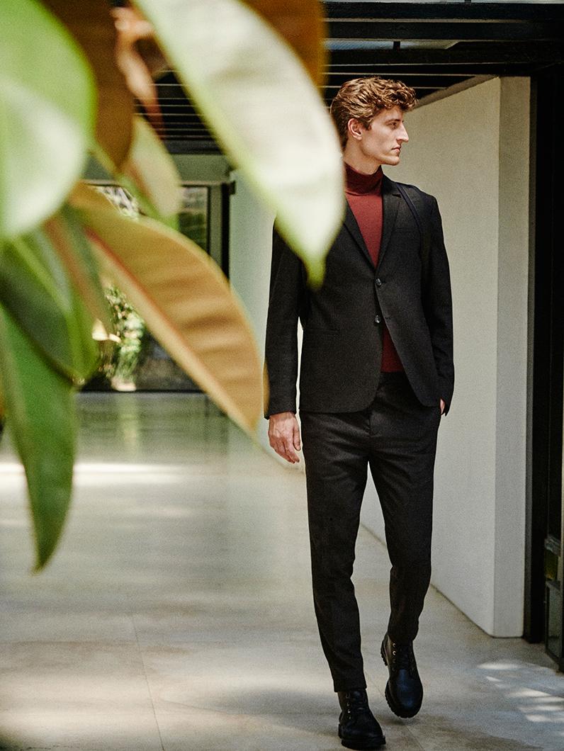 Slim-lapel blazer , £175  Merino roll-neck jumper , £55  Lightweight wool trousers , £79  Lace-up boots , £175  Duffle backpack , £89