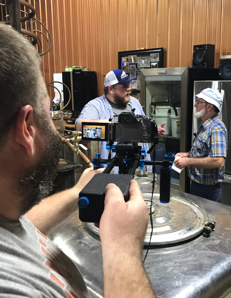 PawPaw being interviewed by Evan Haskill (filmed by Bo Cumberland) at Neeley Family Distillery for our new TV show