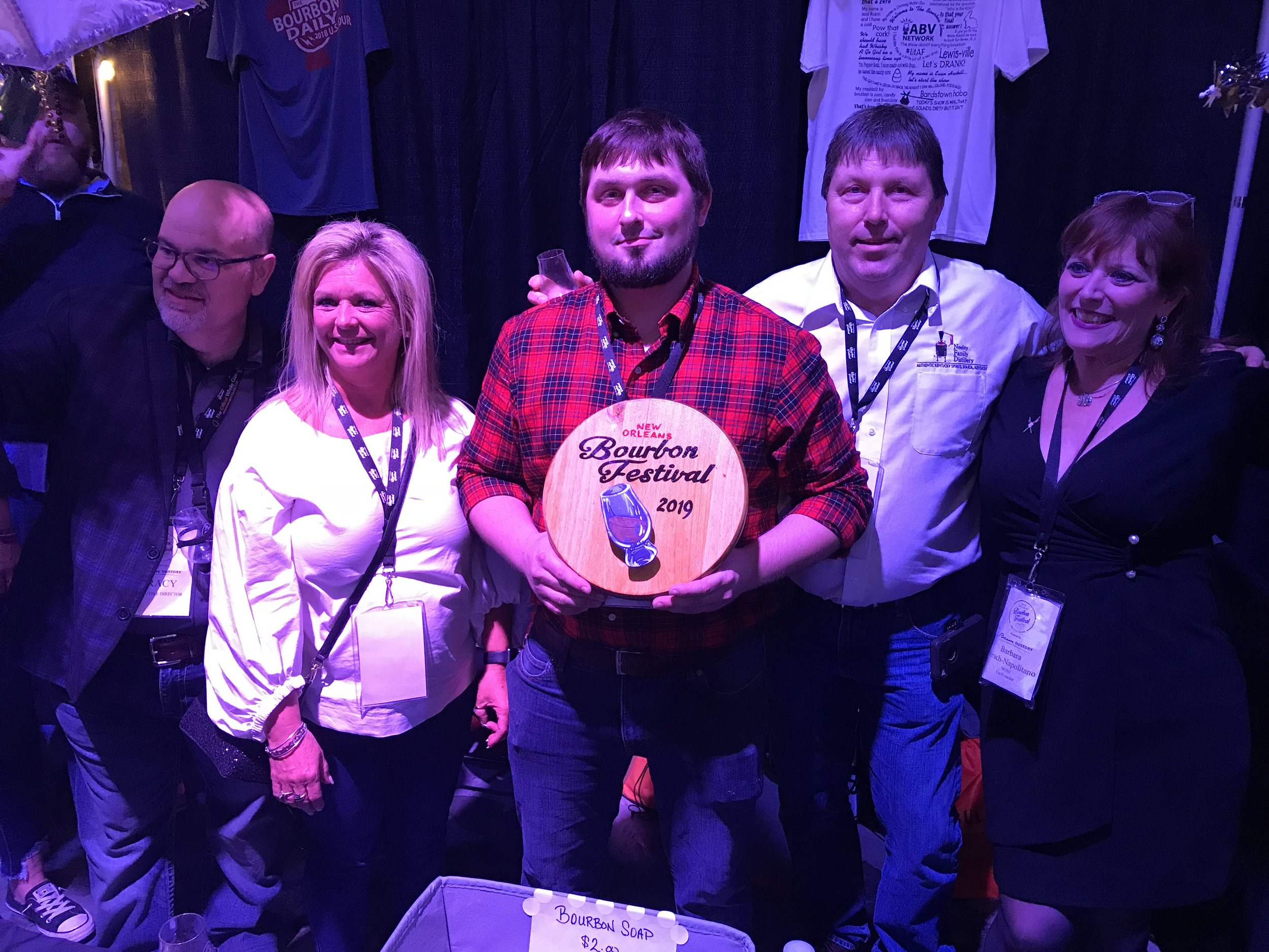 "New Orleans Bourbon Festival organizers Tracy Napolitano (left) and Barbara Hirsch (right) congratulate Michele, Royce and Roy Neeley on their 2nd place award for their bourbon in the ""Under 4-Years"" category."