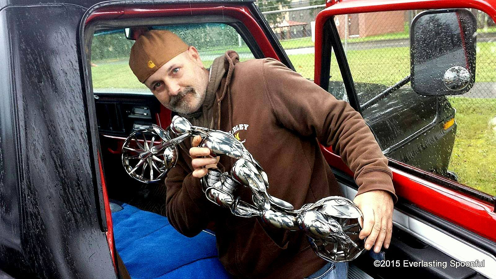 """Artist James Rice, with his spoon motorcycle sculpture """"The Wasp"""""""