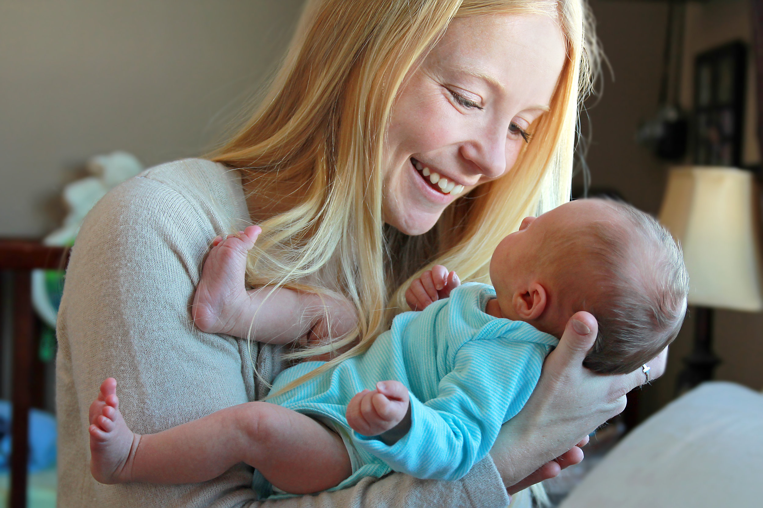 photodune-10909611-young-mother-smiling-at-newborn-baby-in-home-nursery-l.jpg