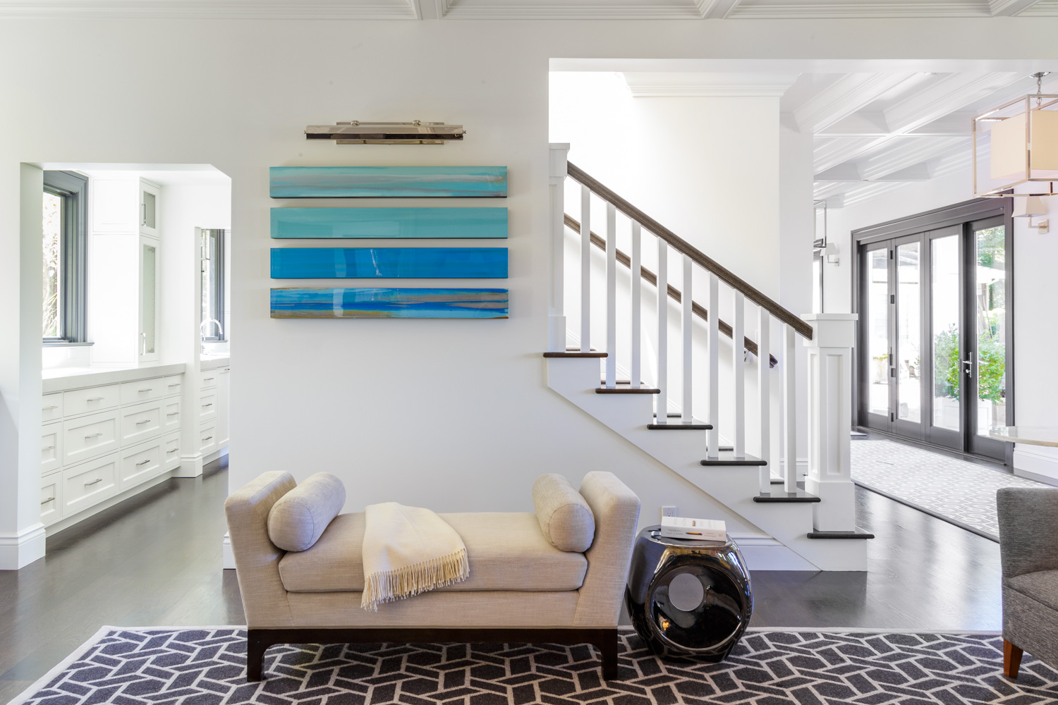 staircase and chaise with contemporary artwork
