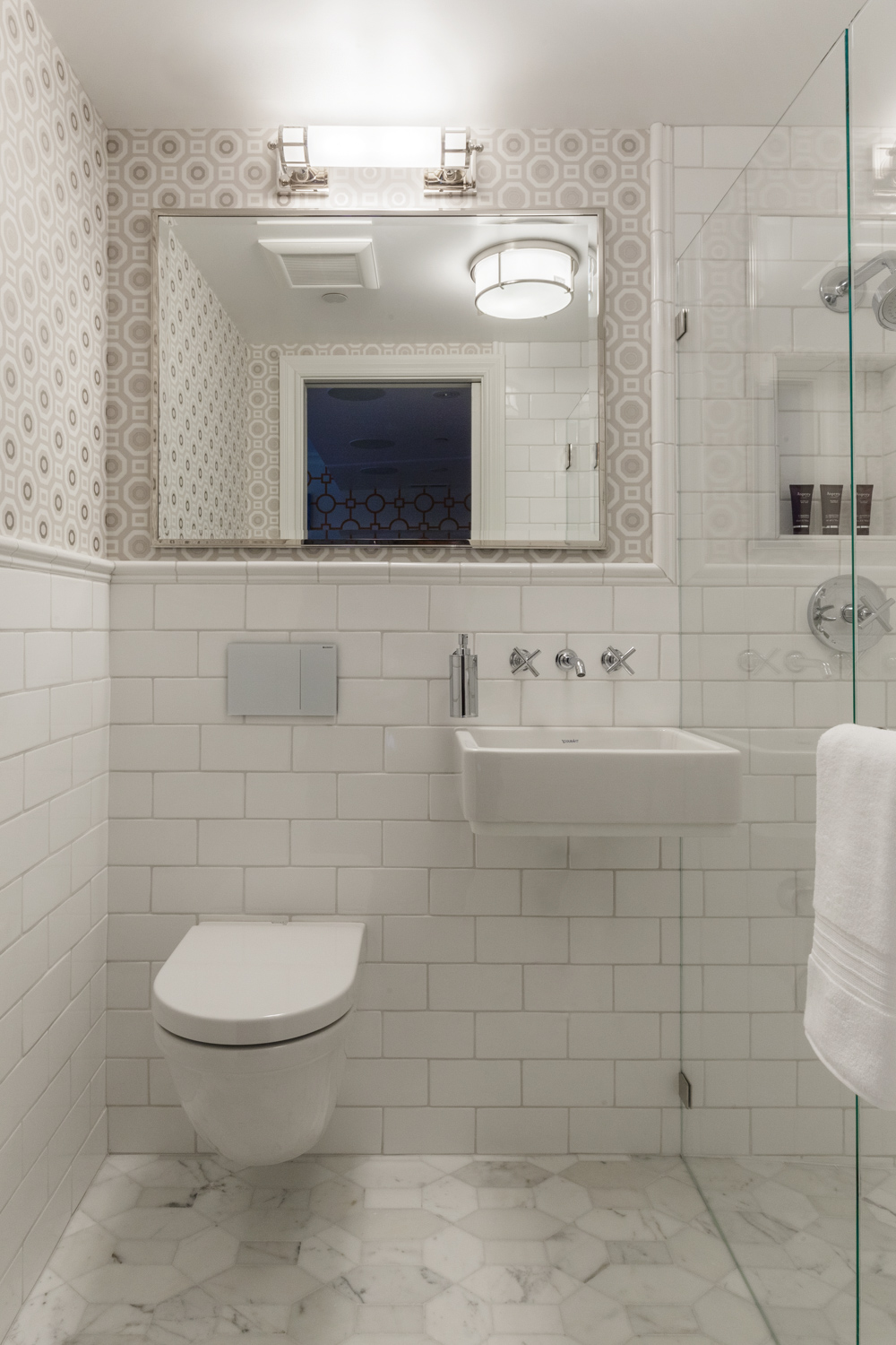 white bathroom with marble tile