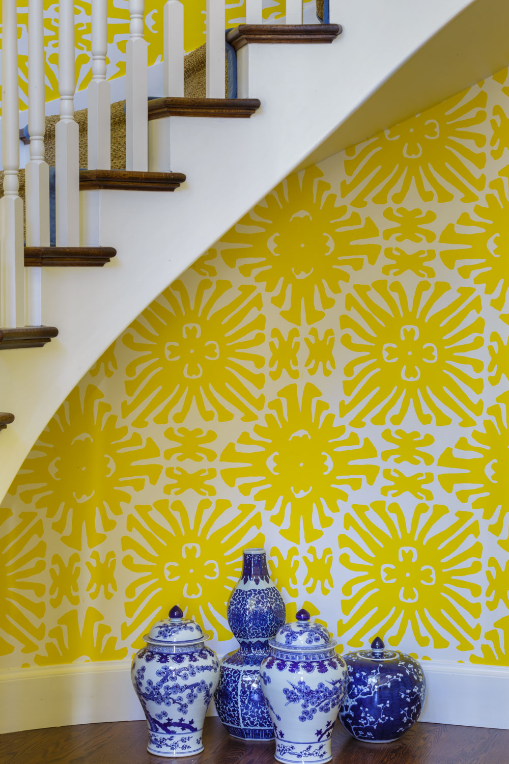 entry staircase with yellow wallpaper