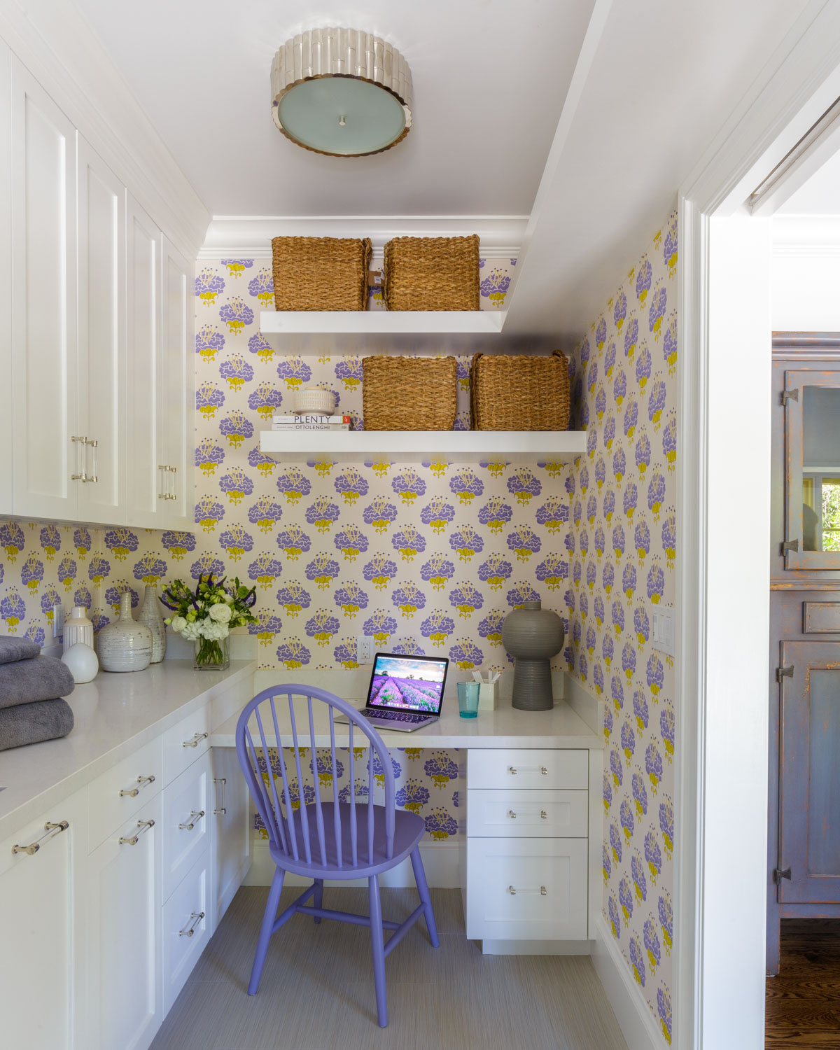 laundry room with graphic wallpaper