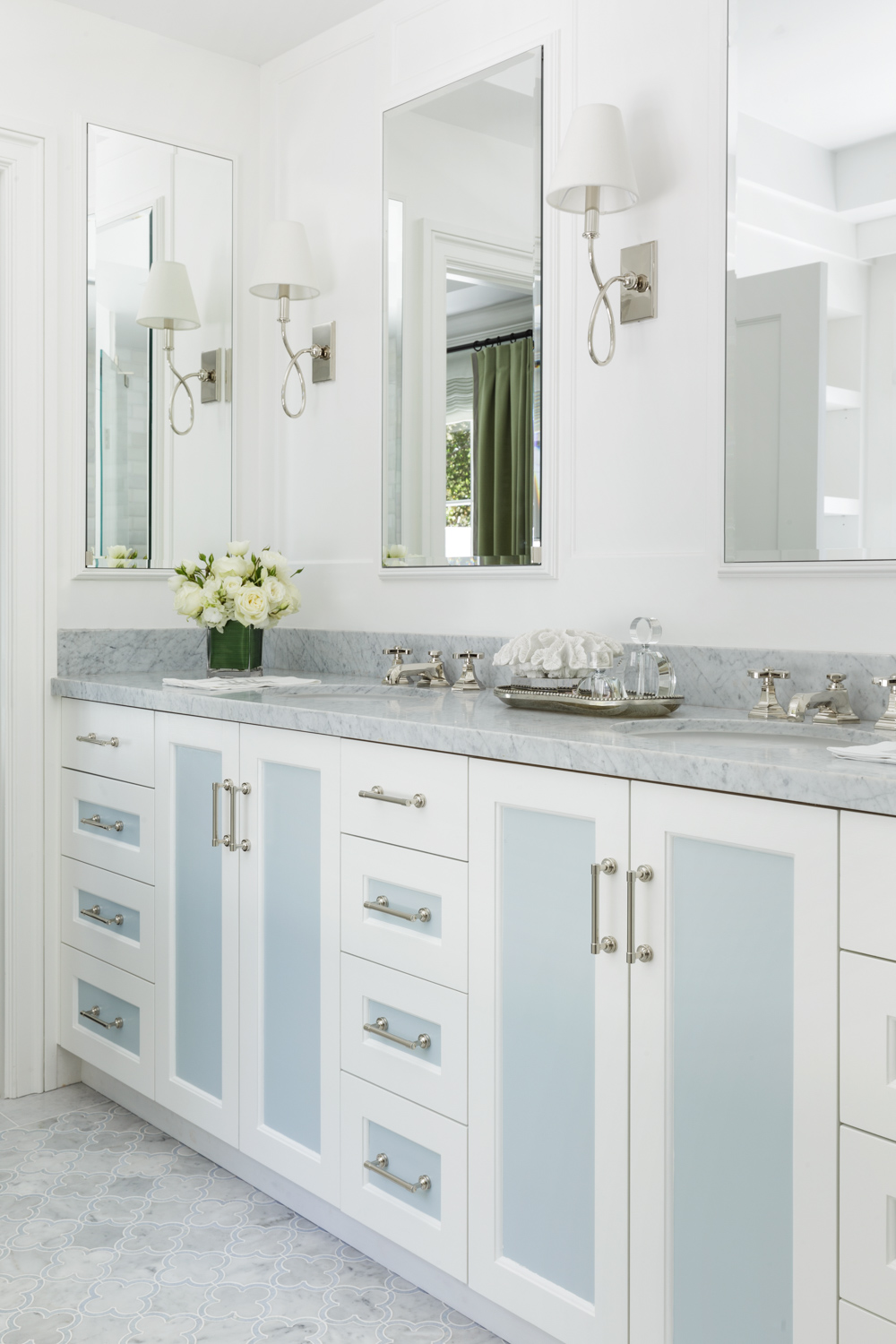 master bath with marble and blue accents