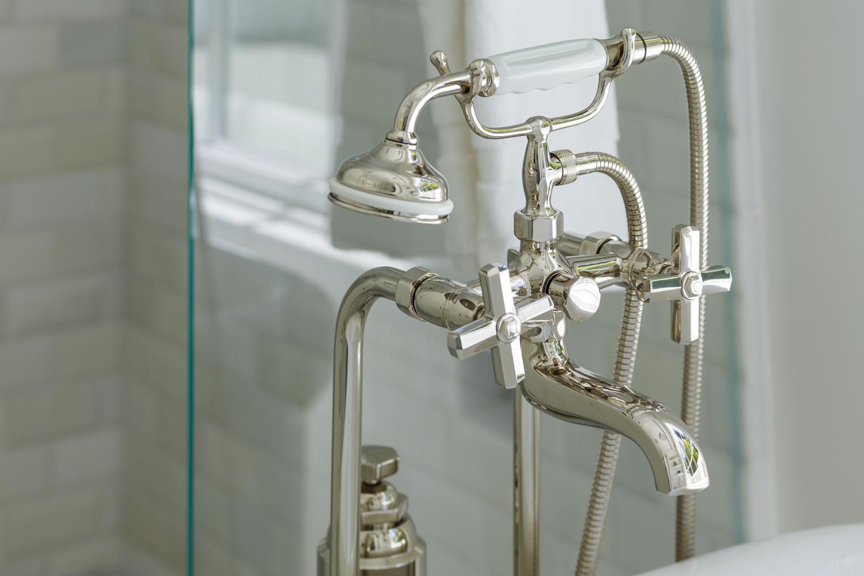 closeup of bath faucet
