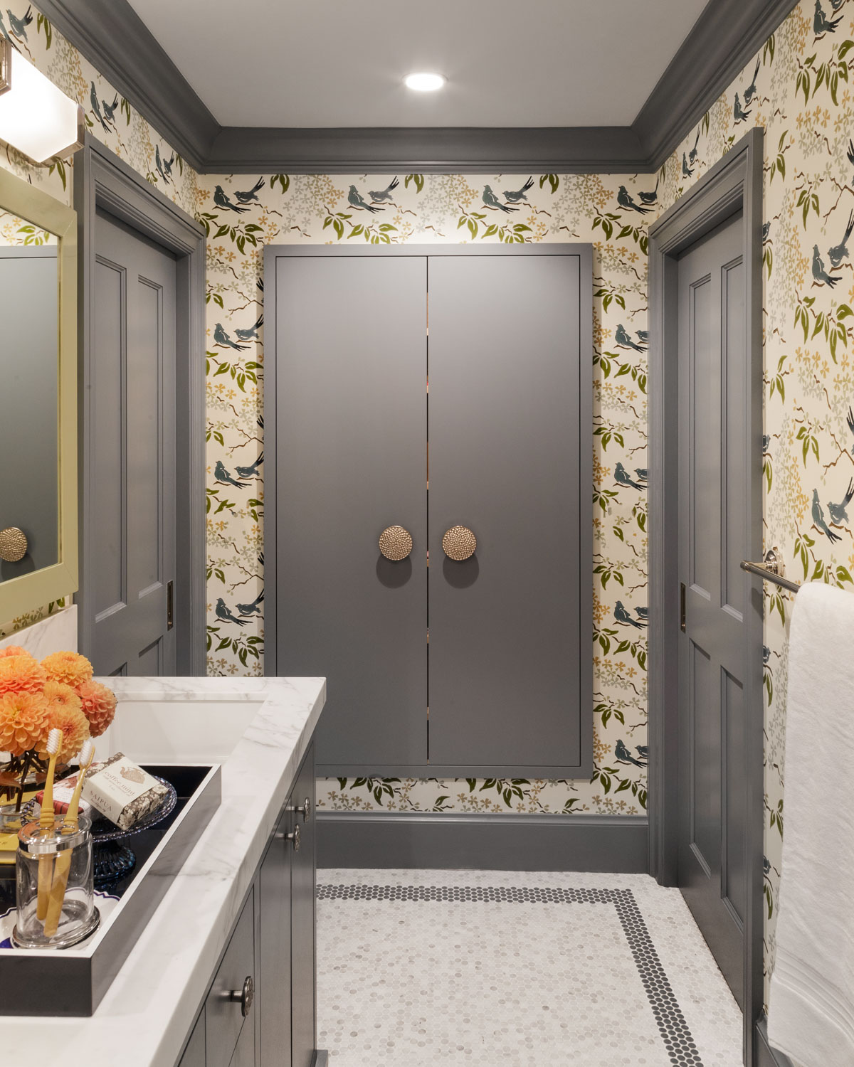 gray bathroom with graphic wallpaper