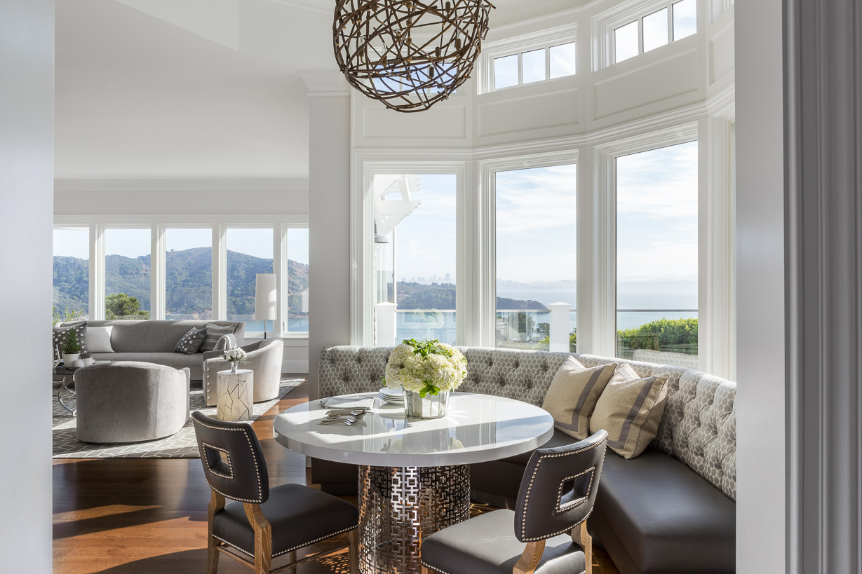 white dining nook with bay window