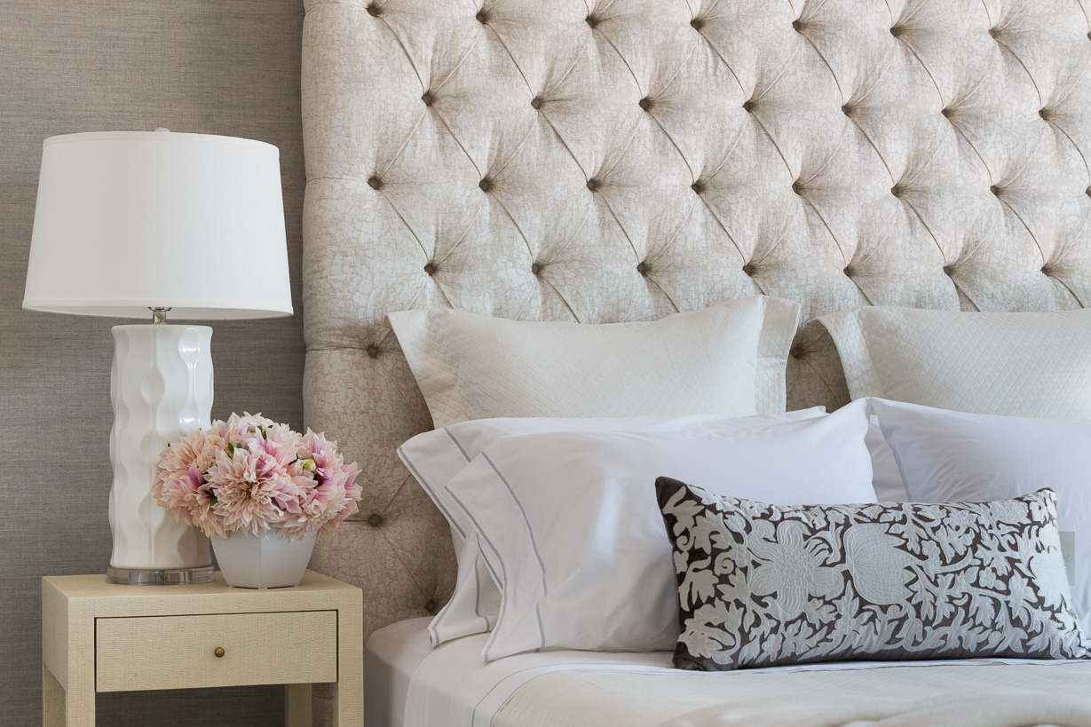 feminine guest bedroom with tufted headboard
