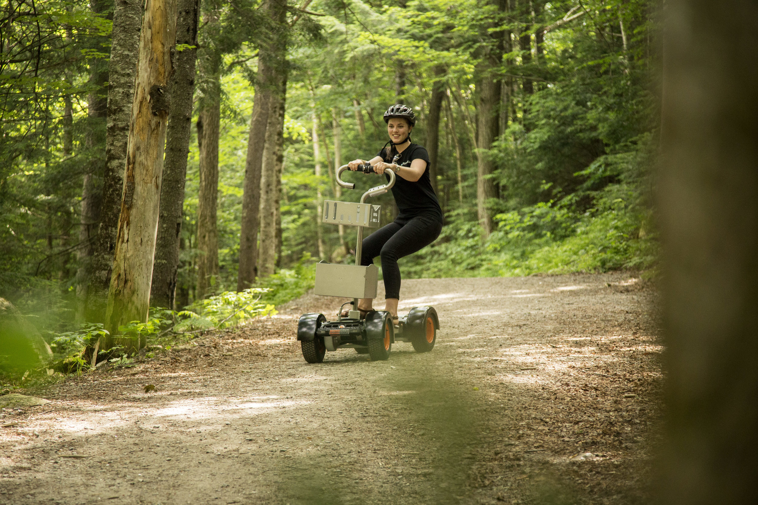 Whitney takes a ResortBoard off road on the Village Trail.