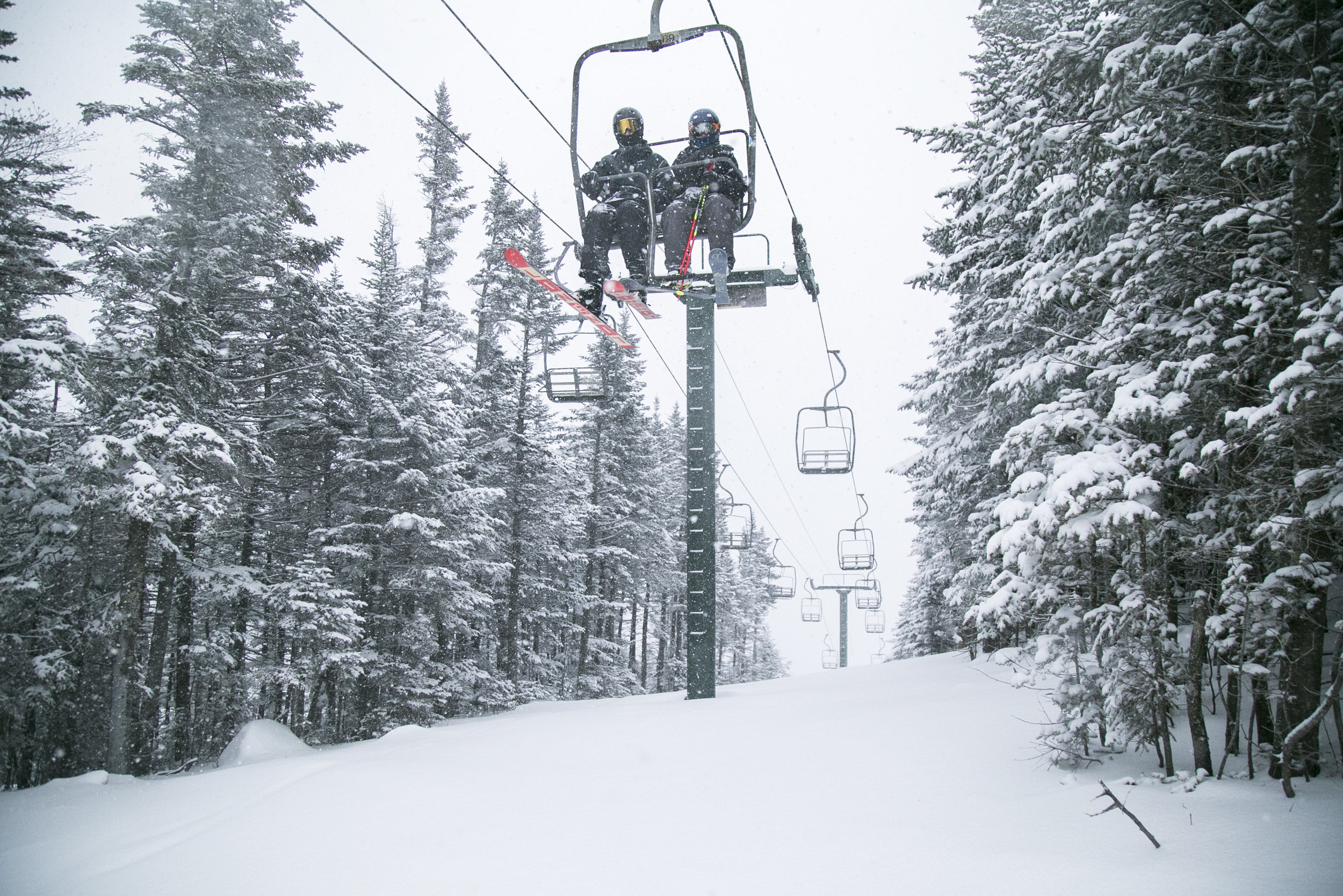 Skiers riding the North Side Lift on a powder day