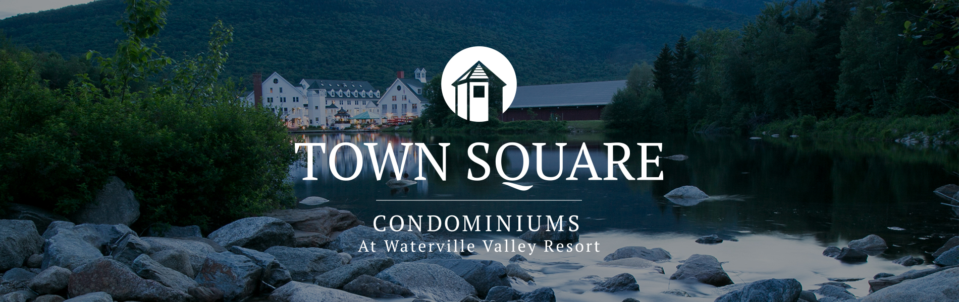 Town Square Condominiums sits on the shores of Corcoran Pond with Mt. Tecumseh serving as the backdrop.