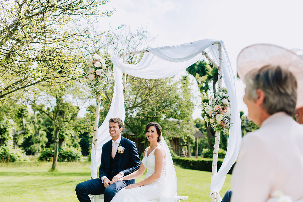 bride and groom smiling wedding ceremony