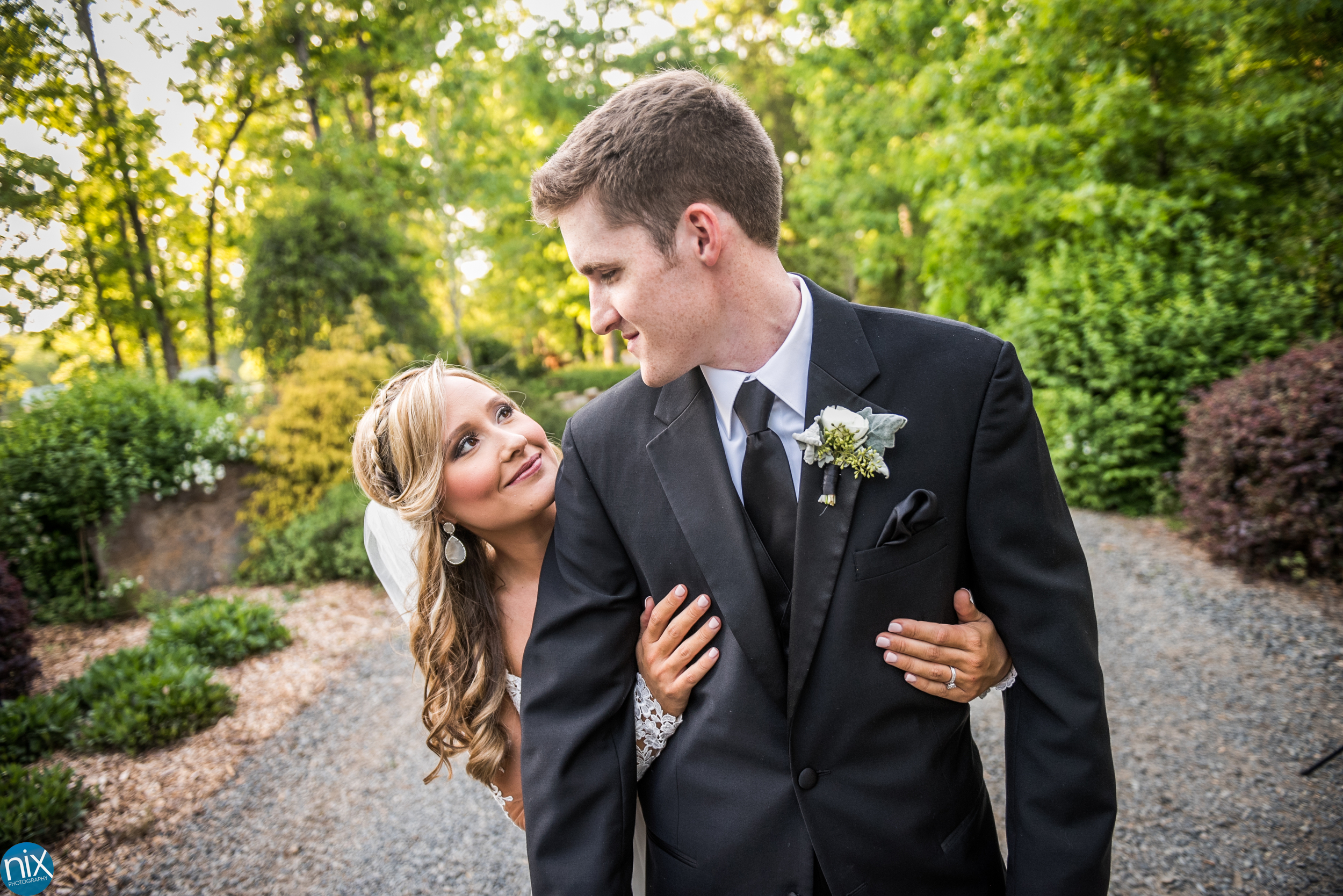 bride and groom at Morning Glory Farm path.jpg