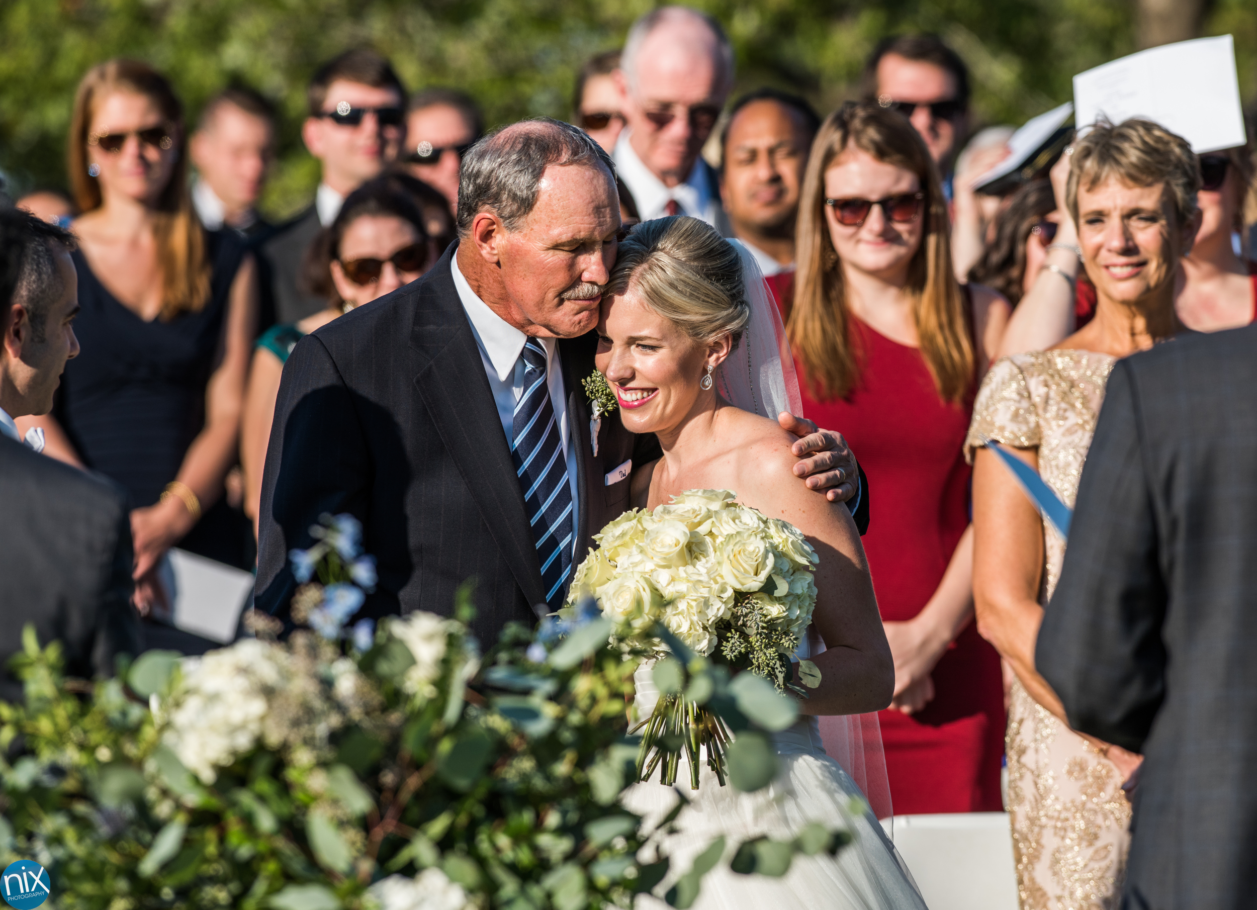 father hands off daughter at wedding at North Stone Country Club in Huntersville.jpg