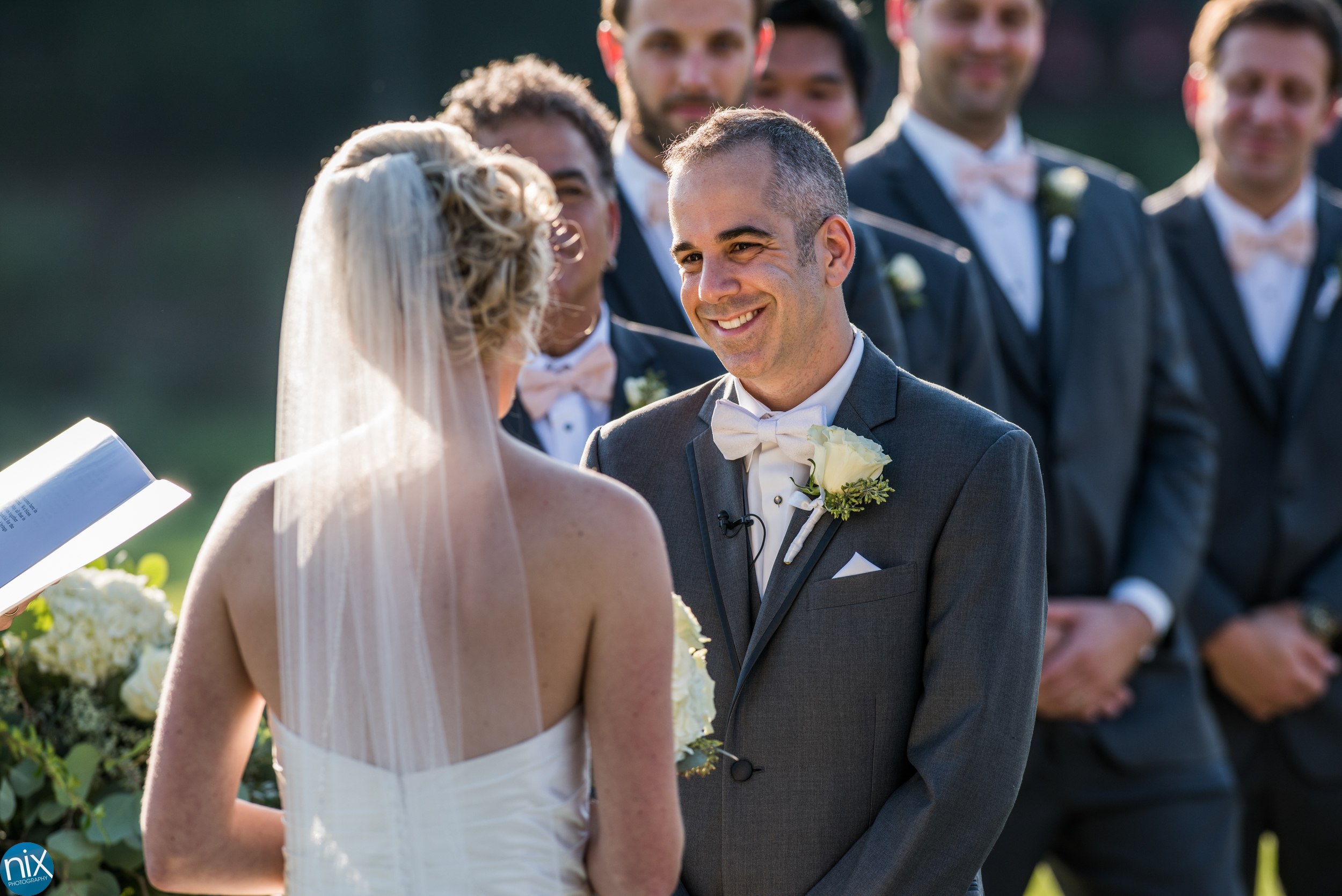 groom smiles at bride at North Stone Country Club in Huntersville.jpg