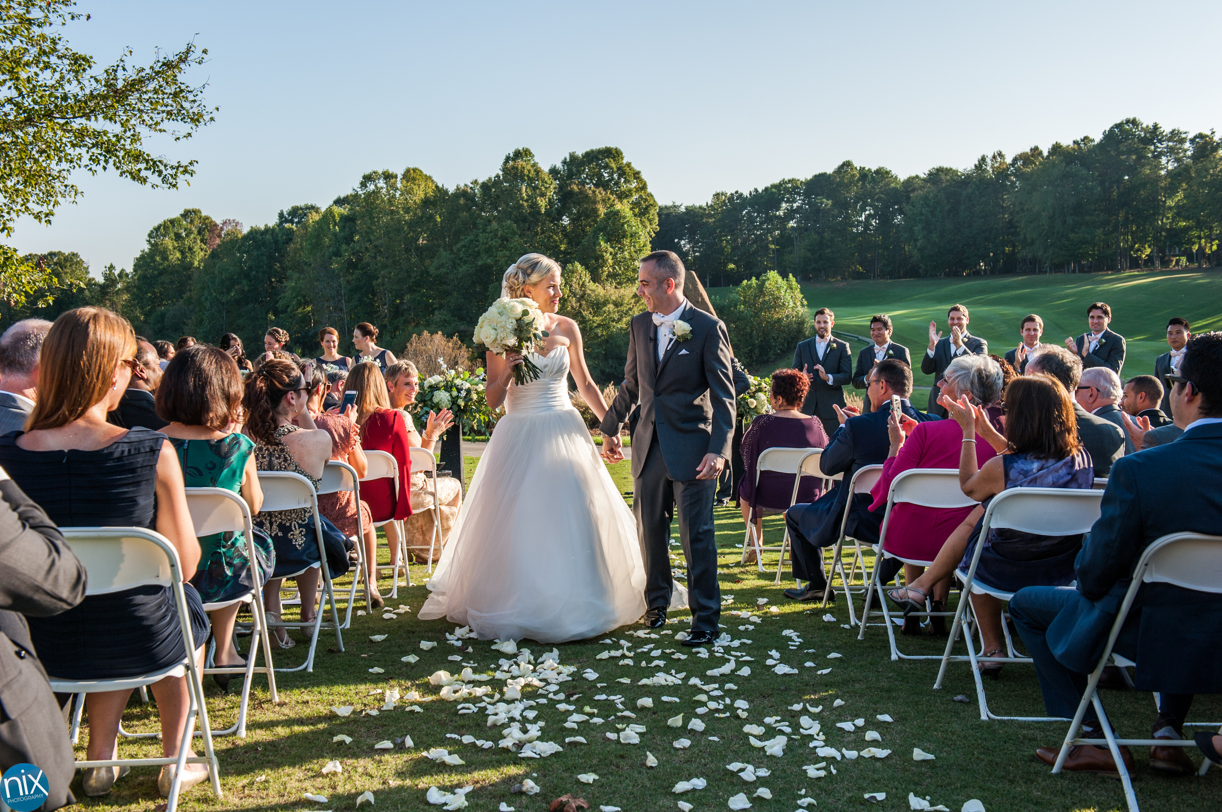 bride and groom get marries North Stone Country Club.jpg