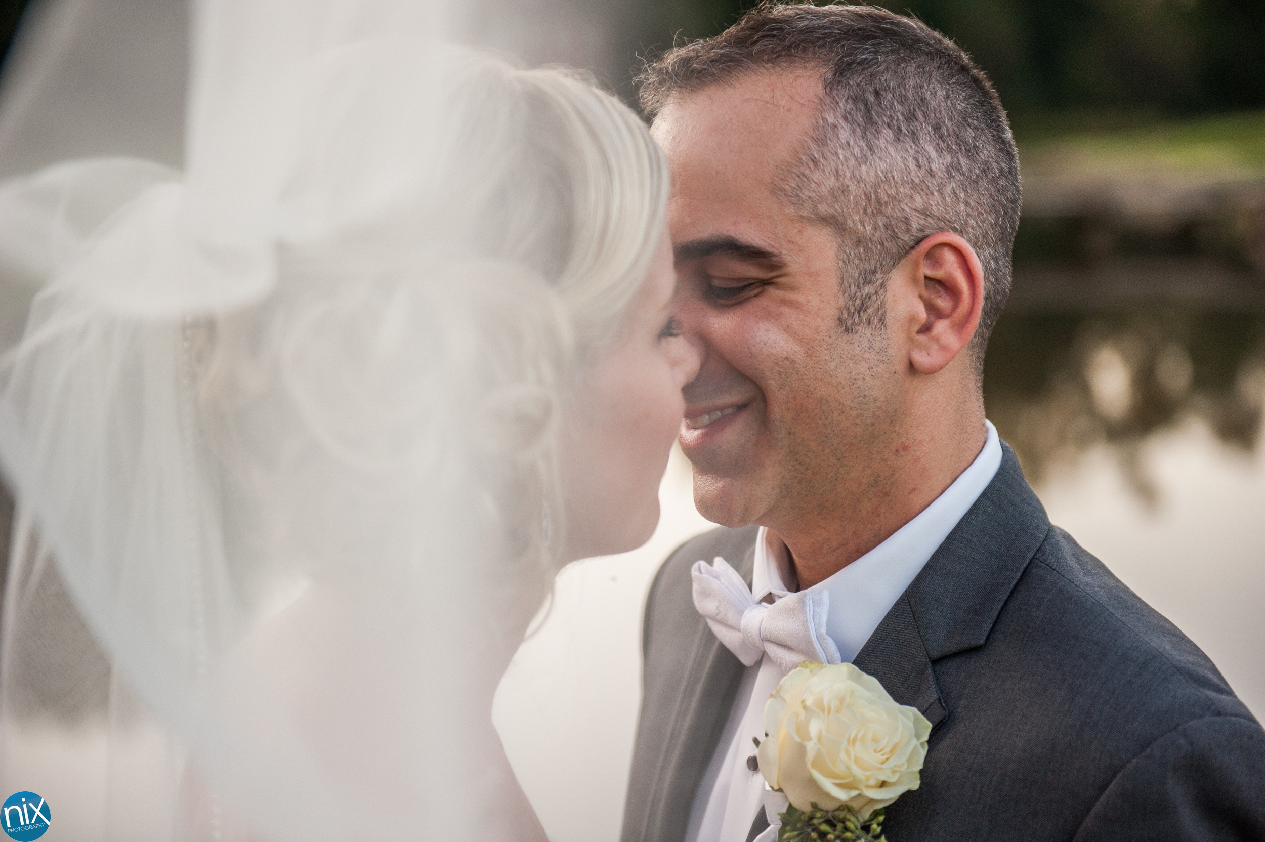 groom and bride at North Stone Country Club in Huntersville.jpg