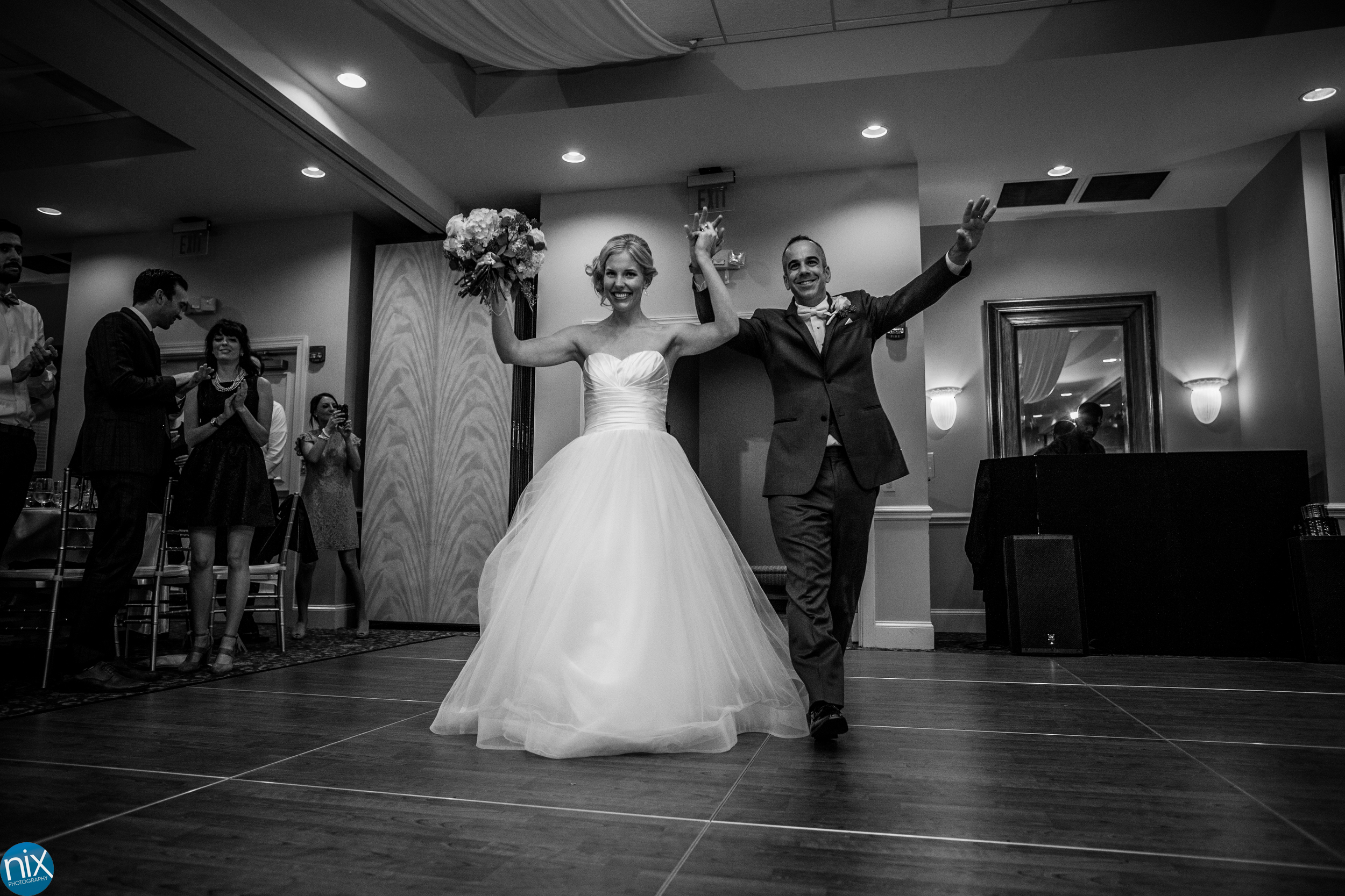 bride and groom are introduced at North Stone Country Club in Huntersville.jpg