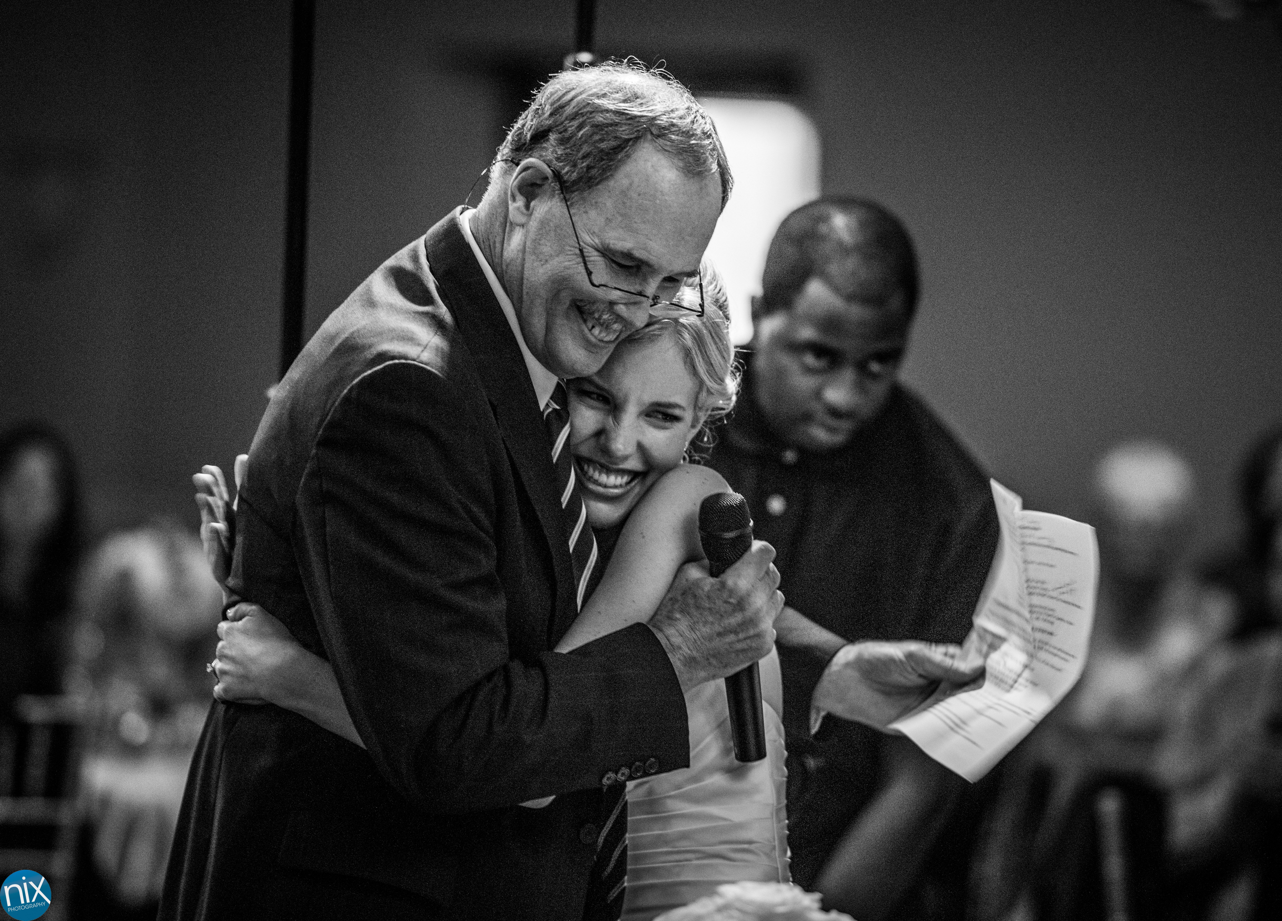 father hugs bride at North Stone Country Club in Huntersville.jpg