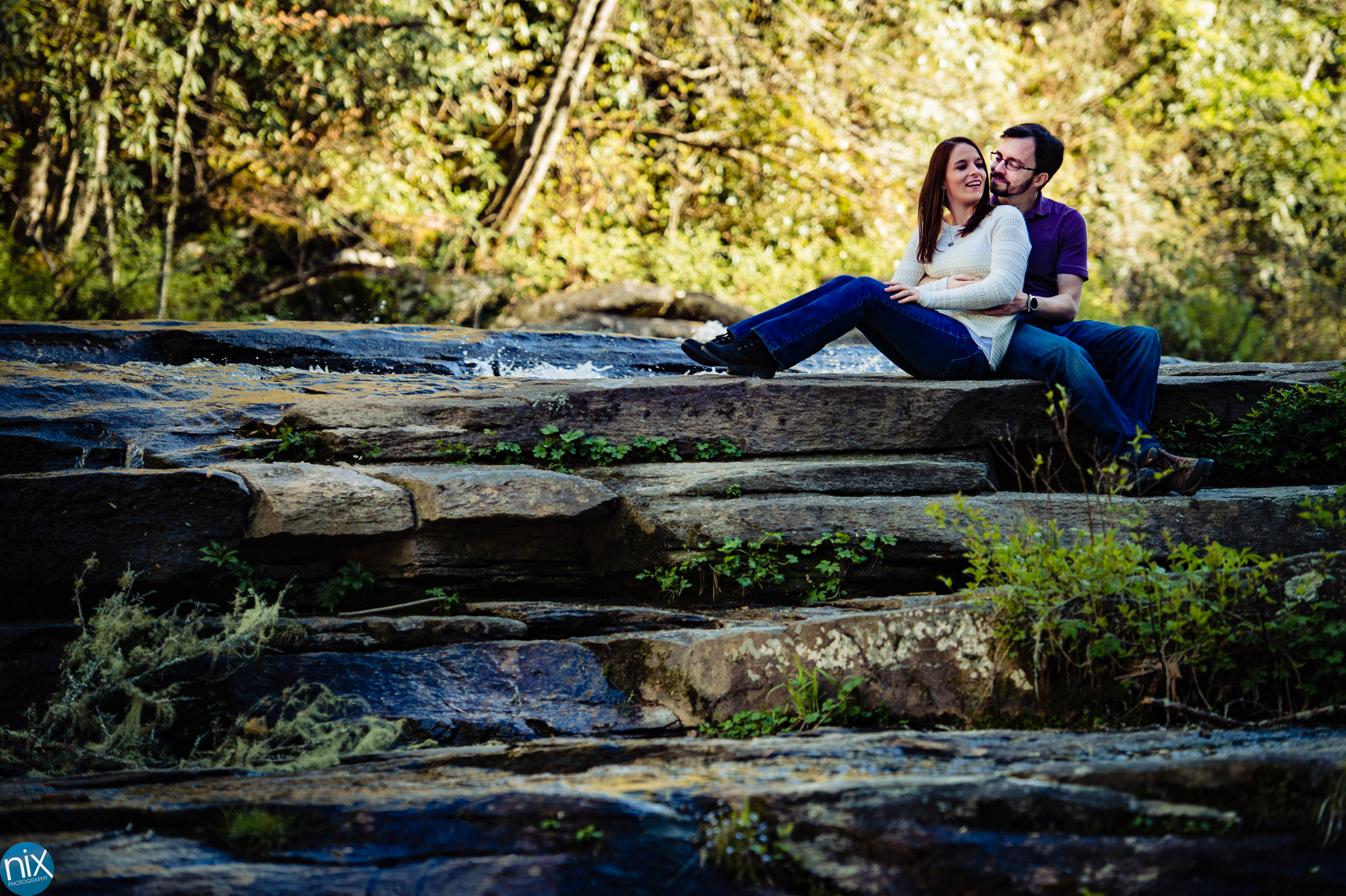 couple-sitting-on-rocks-by-river-DuPont-State-Forest.jpg
