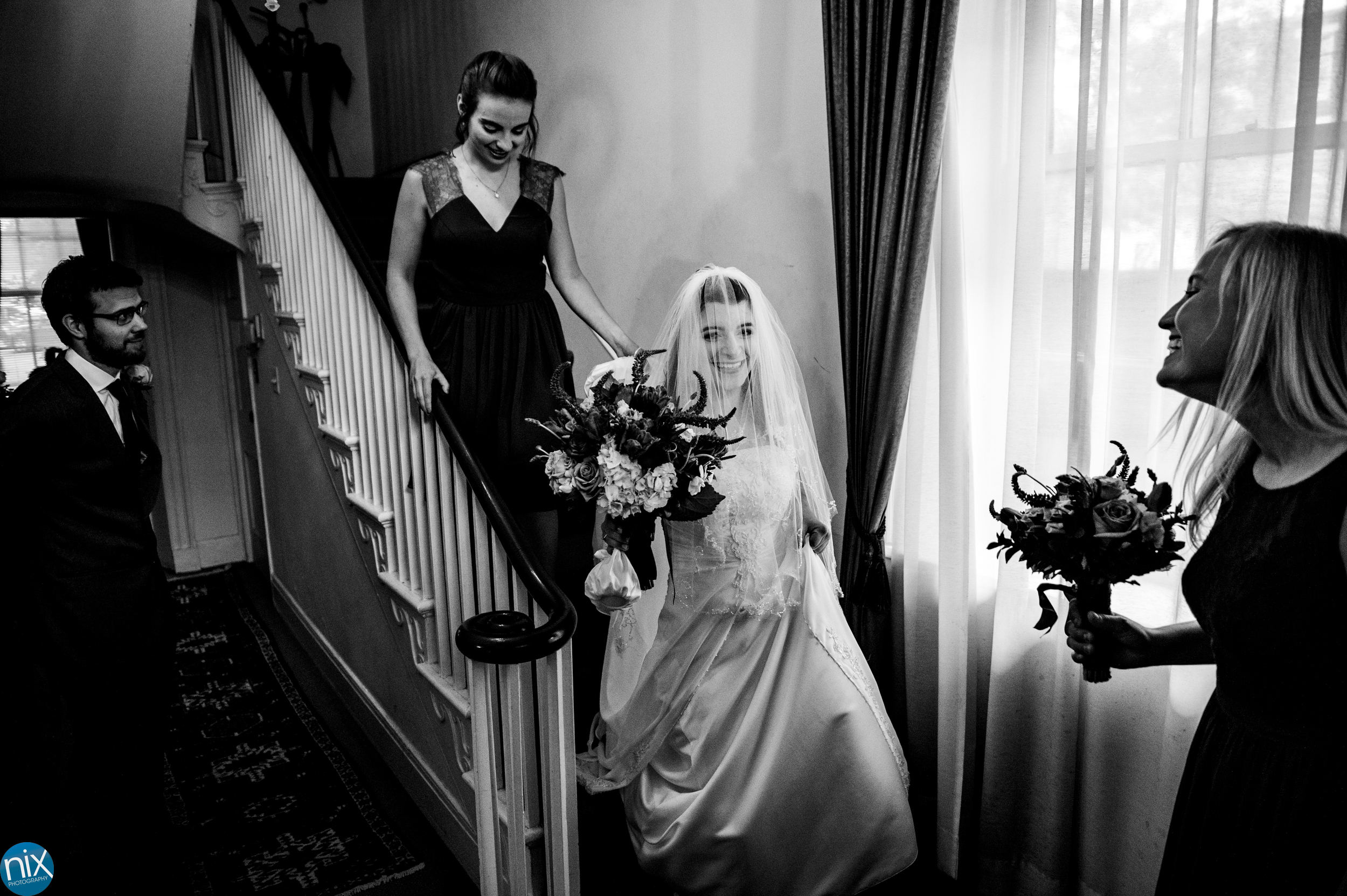 bride_comes_down_stairs_york_wedding_chapel.jpg