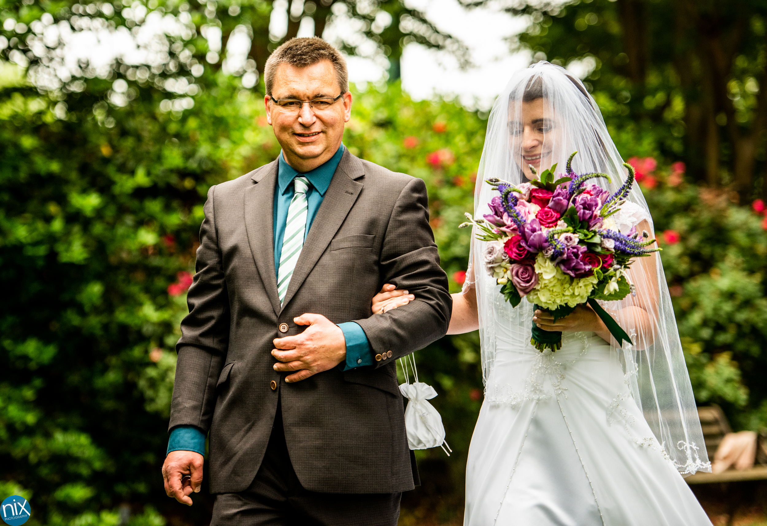 bride_walks_with_father_york_wedding_chapel.jpg