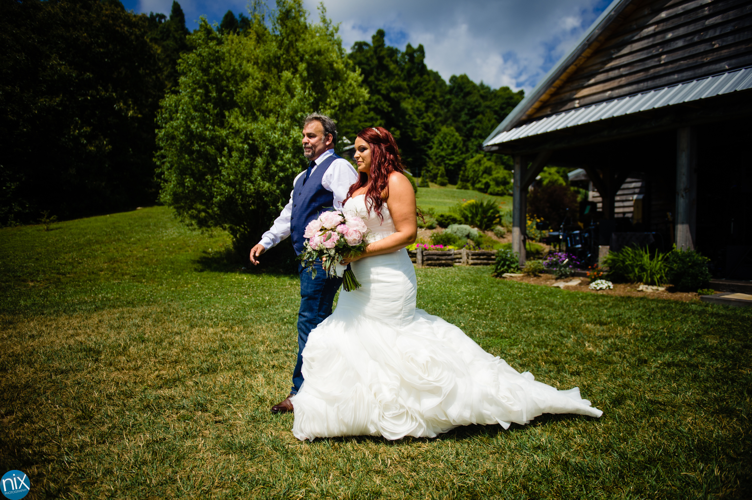 bride_walks_down_aisle_the_cabin_ridge.jpg