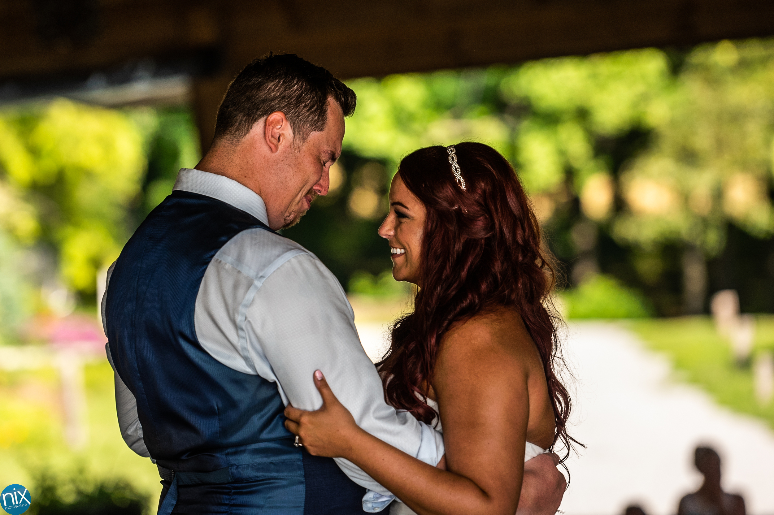 groom cries during first dance at the cabin ridge.jpg
