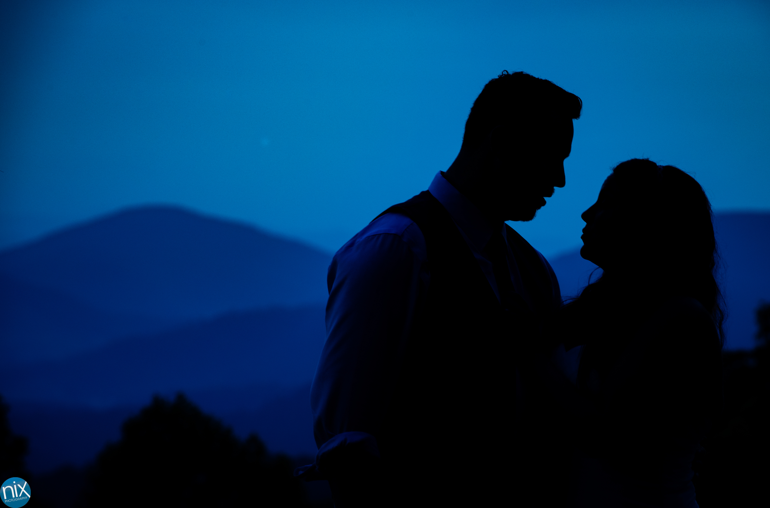 silhouette of bride and groom in the blue ridge mountains.jpg