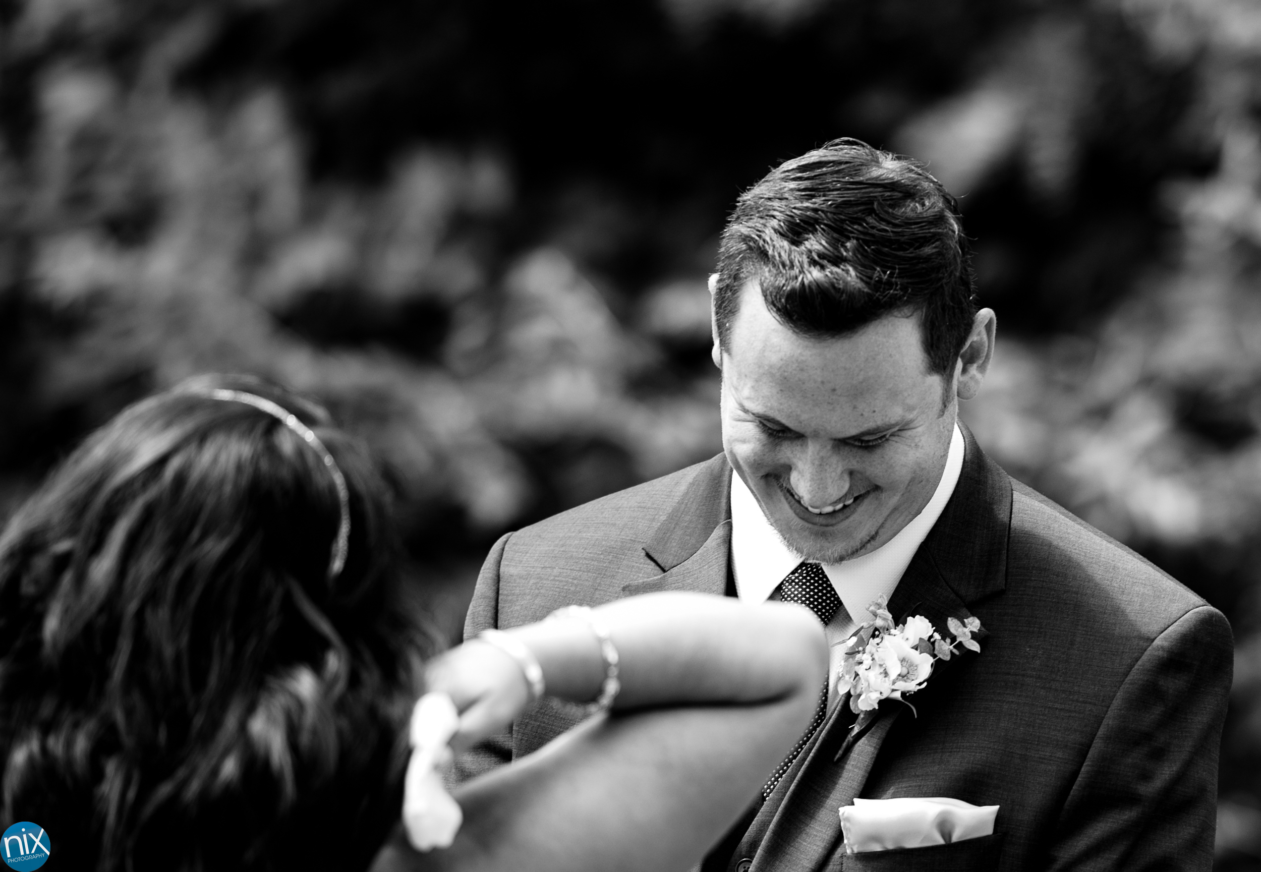 groom laughs during mountain wedding in Hendersonville north carolina.jpg