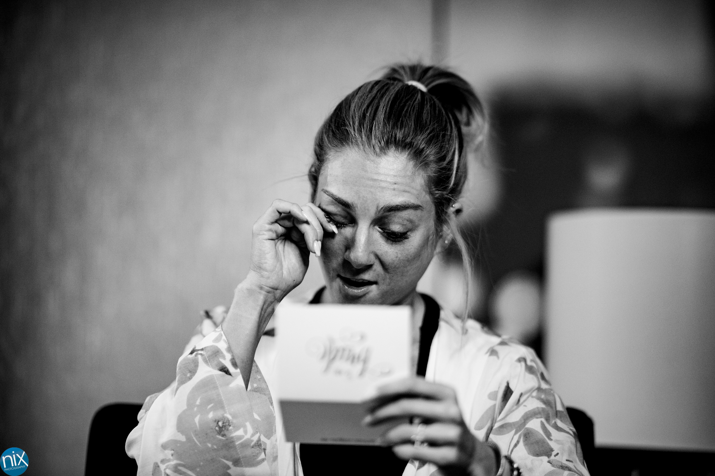 bride cries while reading note at omni hotel.jpg