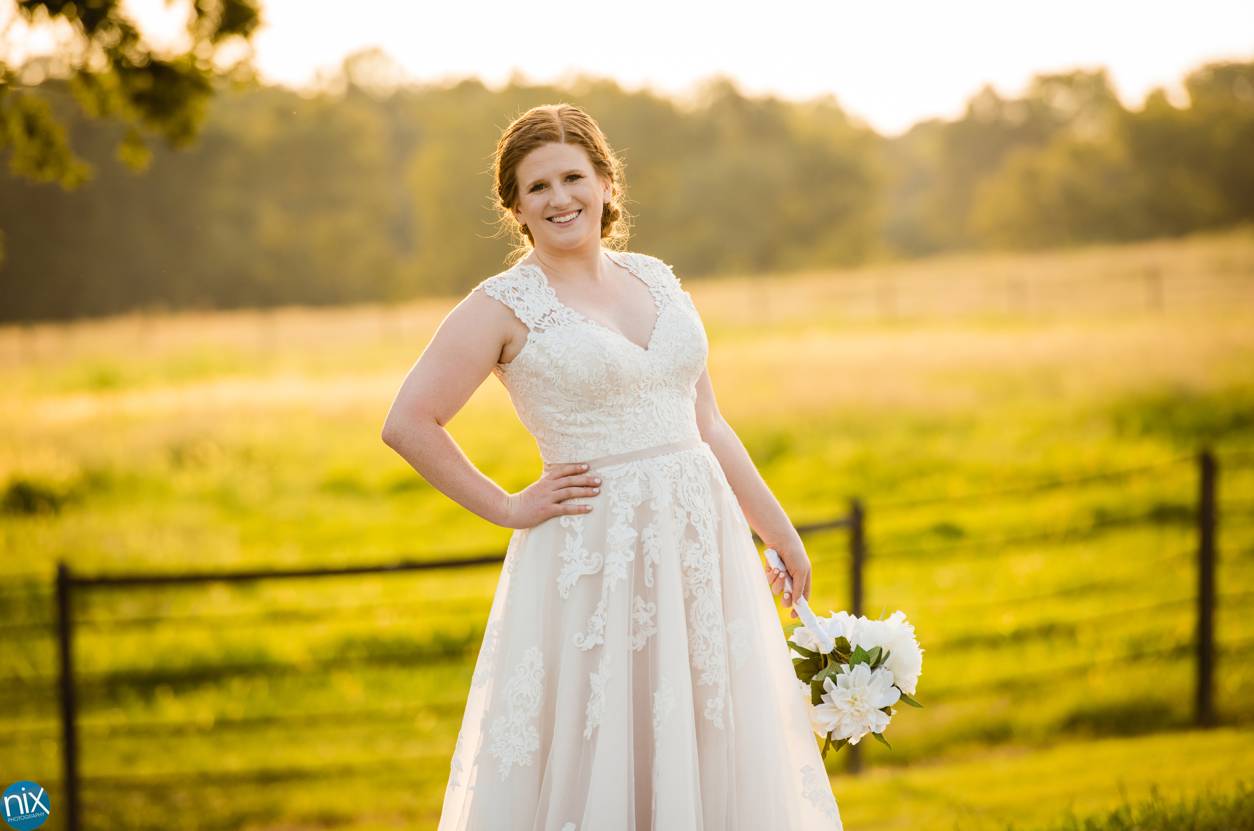 bridal in wedding dress with farm pasture .jpg