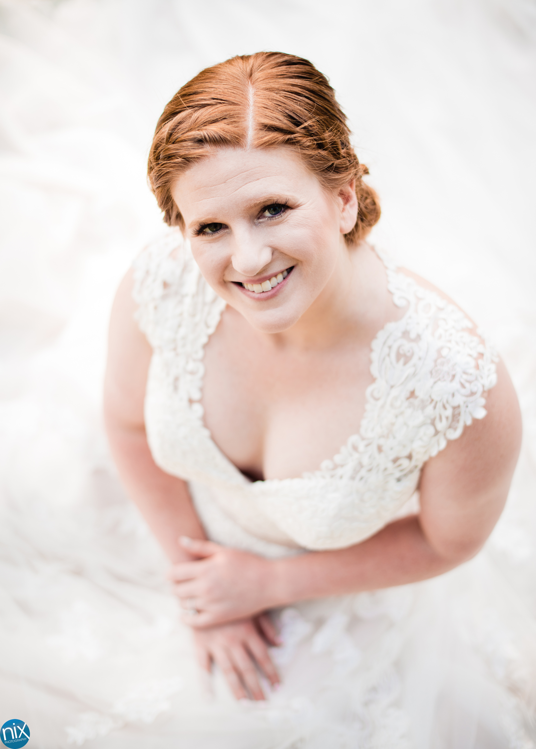 bride sitting in wedding dress.jpg
