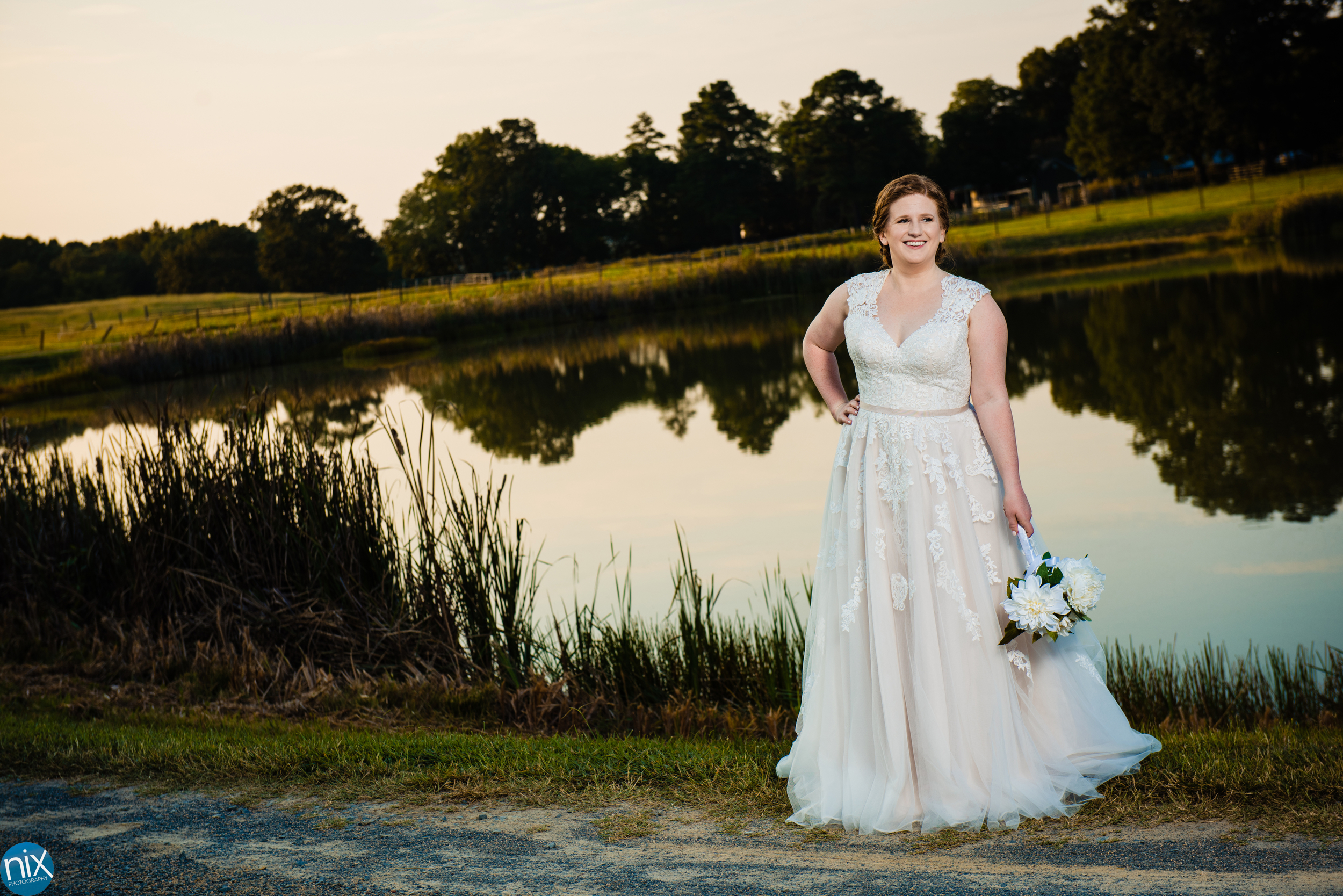 bride wearing a wedding dress at farm at brusharbor.jpg