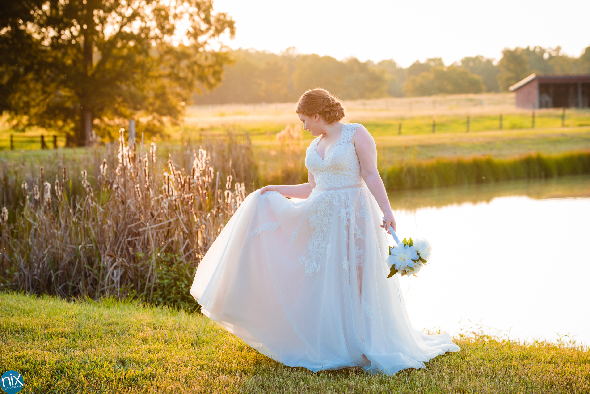 farm at brusharbor wedding dress pond.jpg