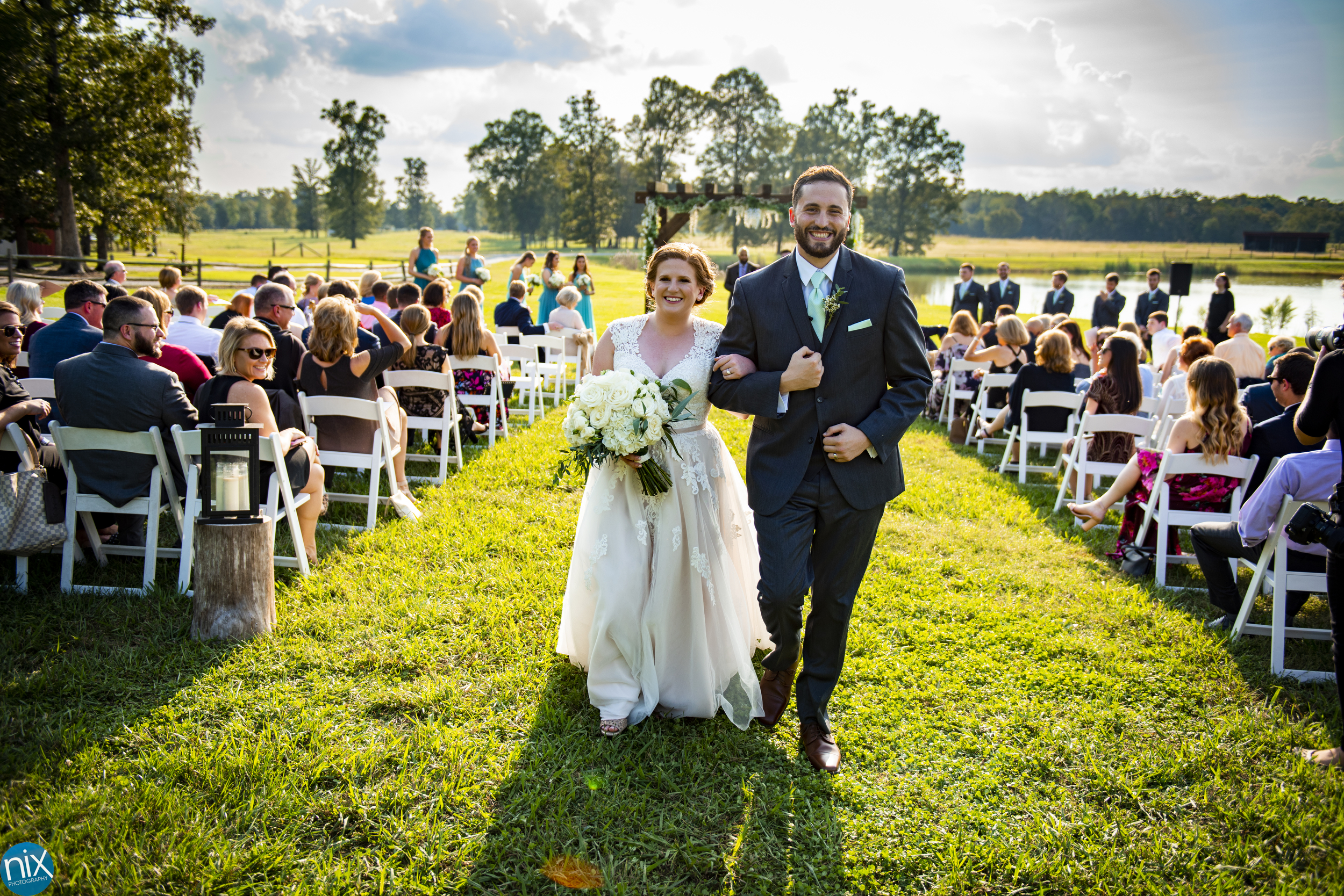 bride and groom walk down aisle Farm at Brusharbor Wedding.jpg