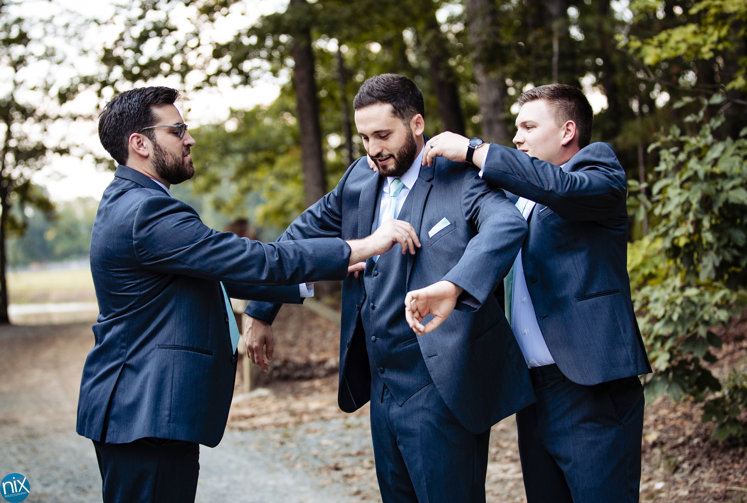 groomsmen help groom get ready farm at brusharbor.jpg