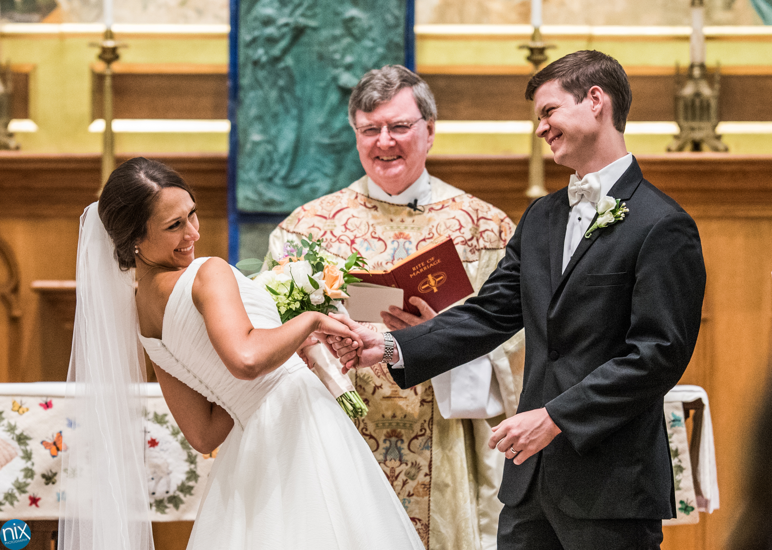 bride and groom are married at St Peters Catholic Church.jpg