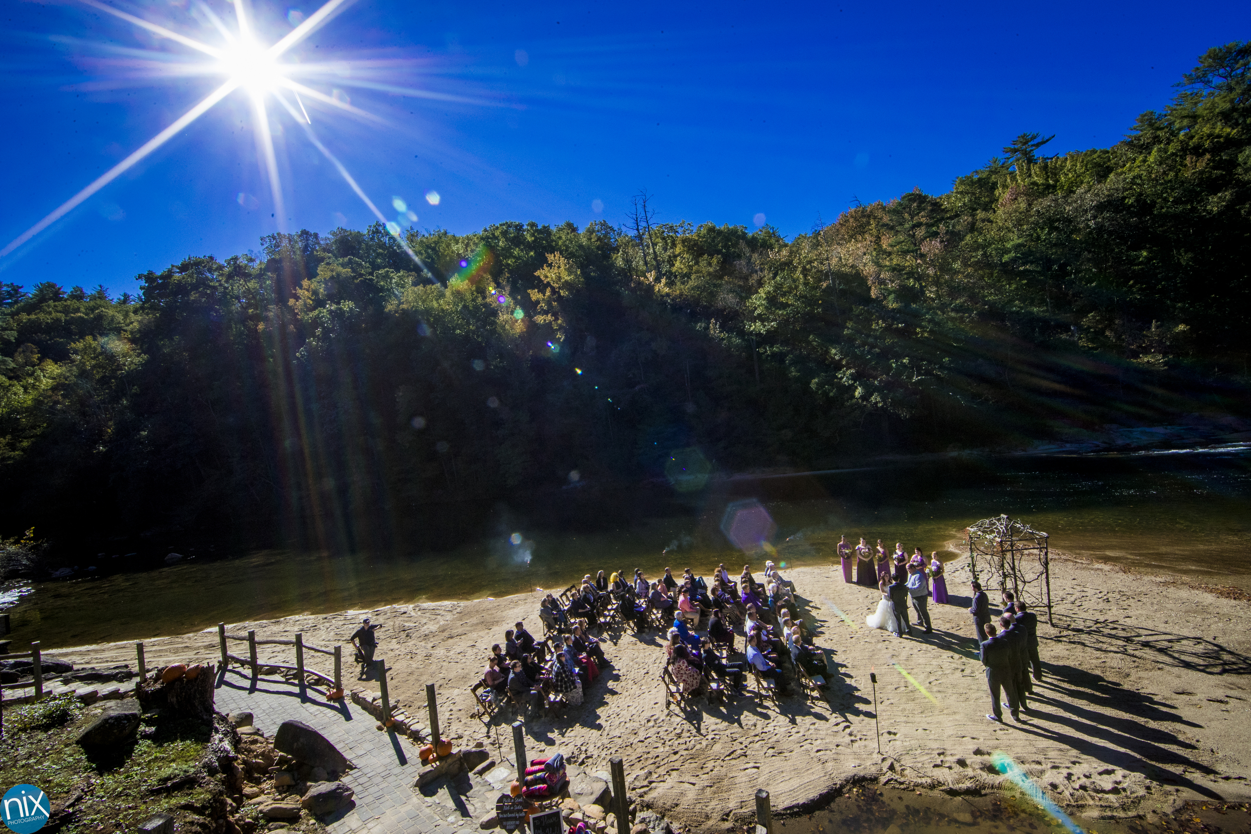 sun shines on wedding at Brown Mountain Beach Resort.jpg