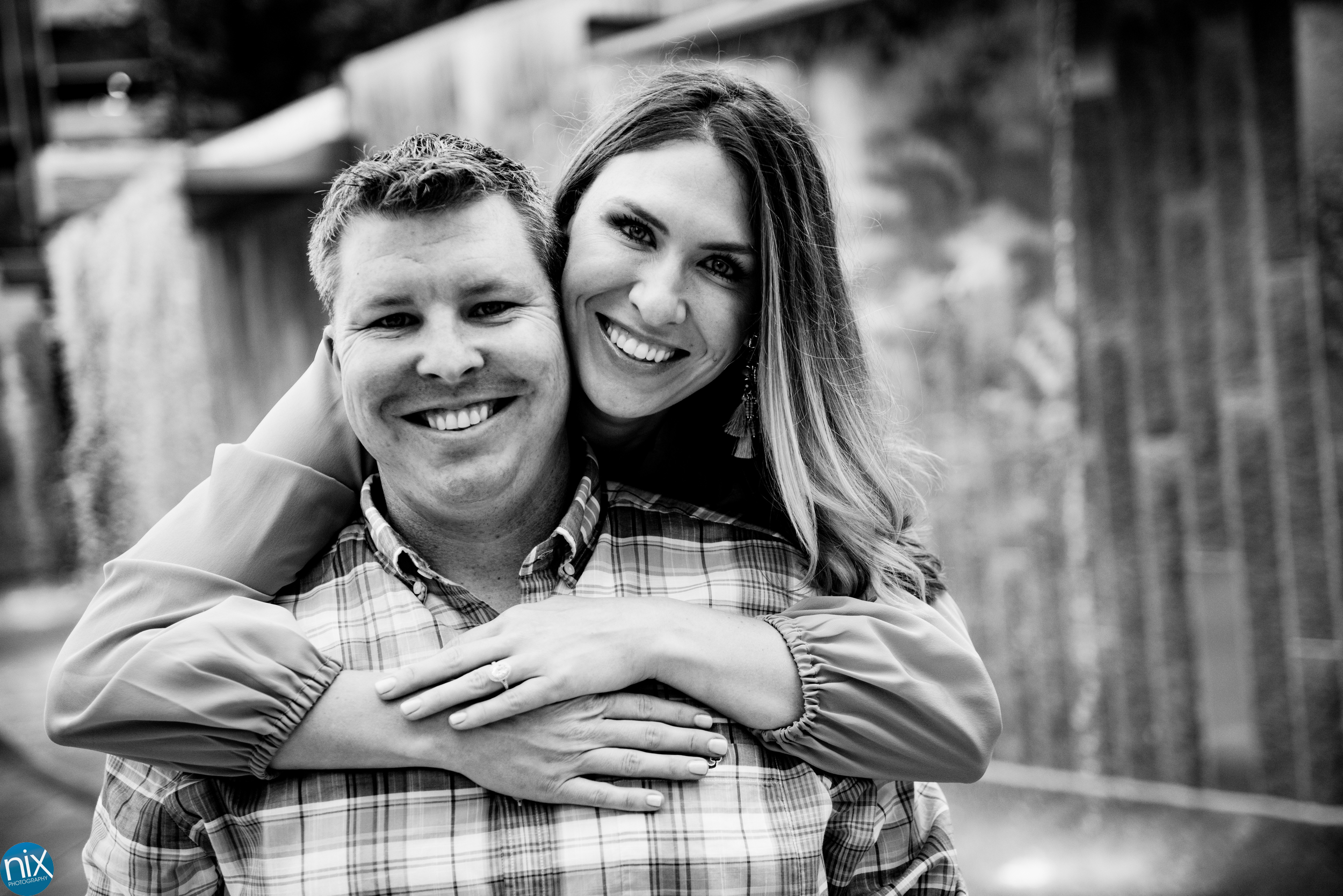 charlotte engagement at romare beardon park waterfall black and white.jpg