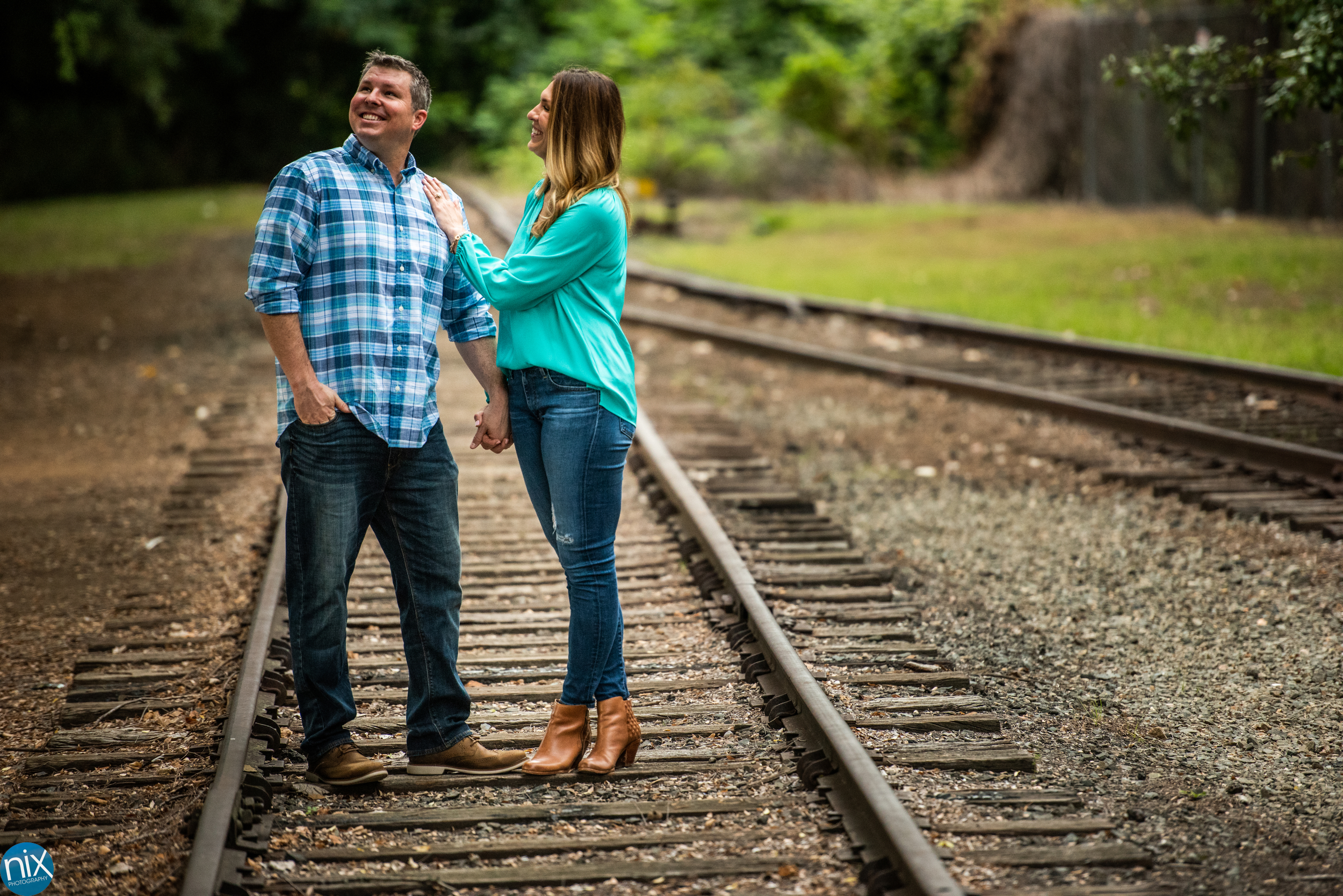 charlotte engagement on old rail road track.jpg