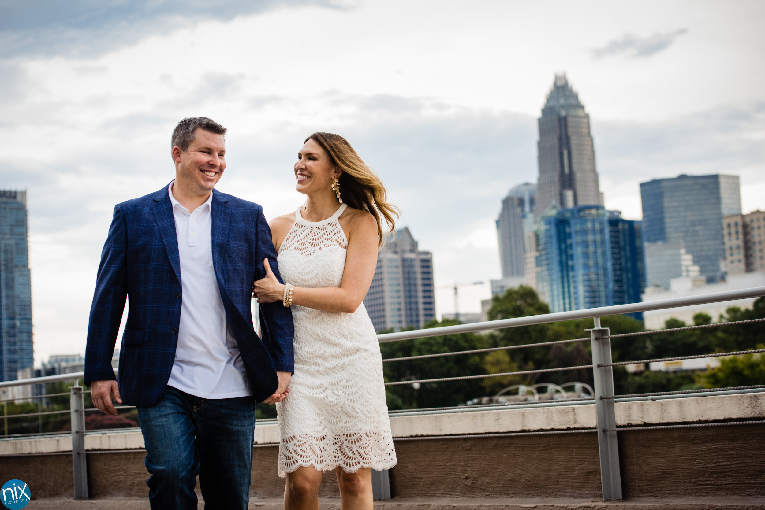 couple walks with Charlotte skyline at Terrace at Cedar Hill.jpg
