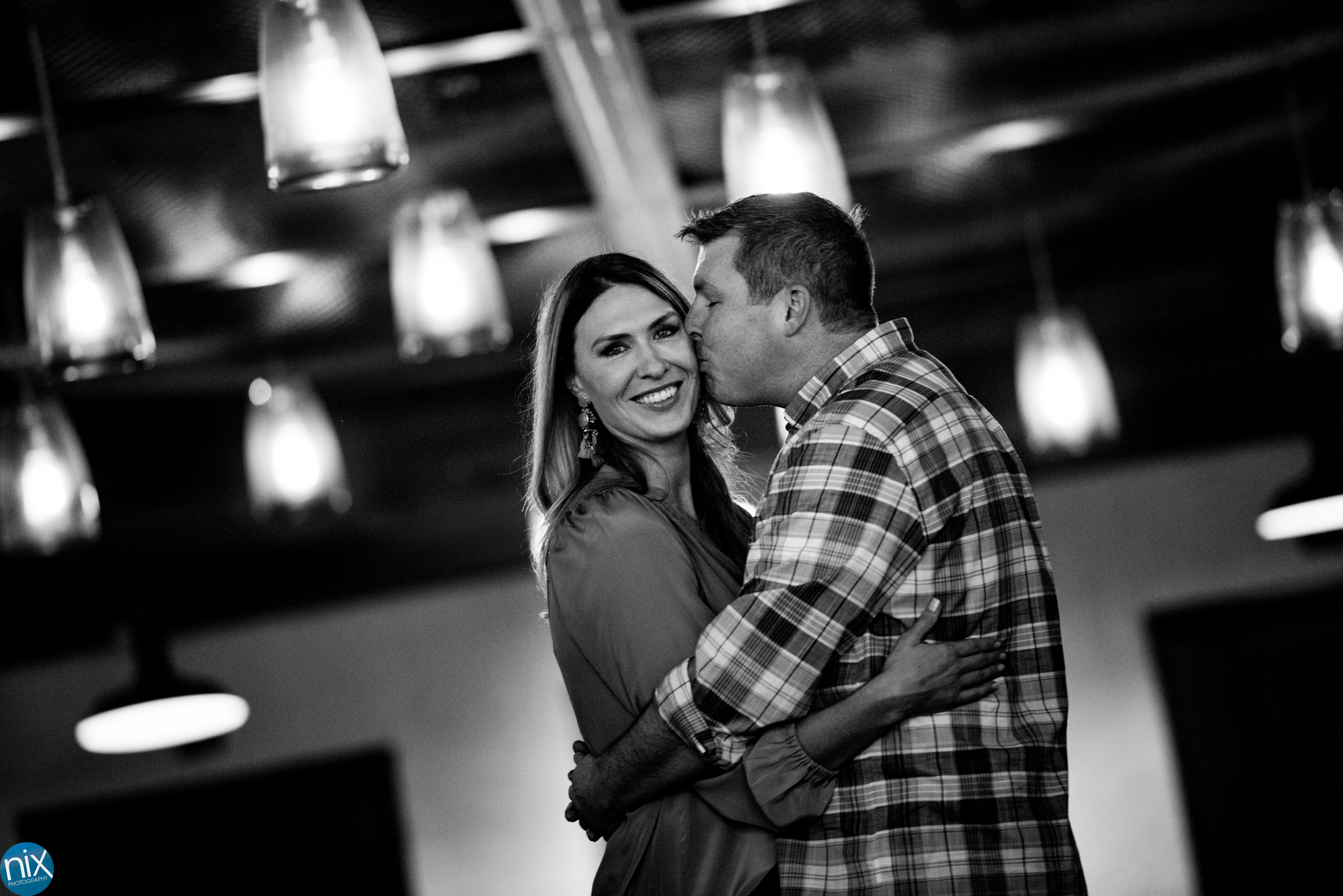 engagment under the lights at Terrace at Cedar Hill.jpg
