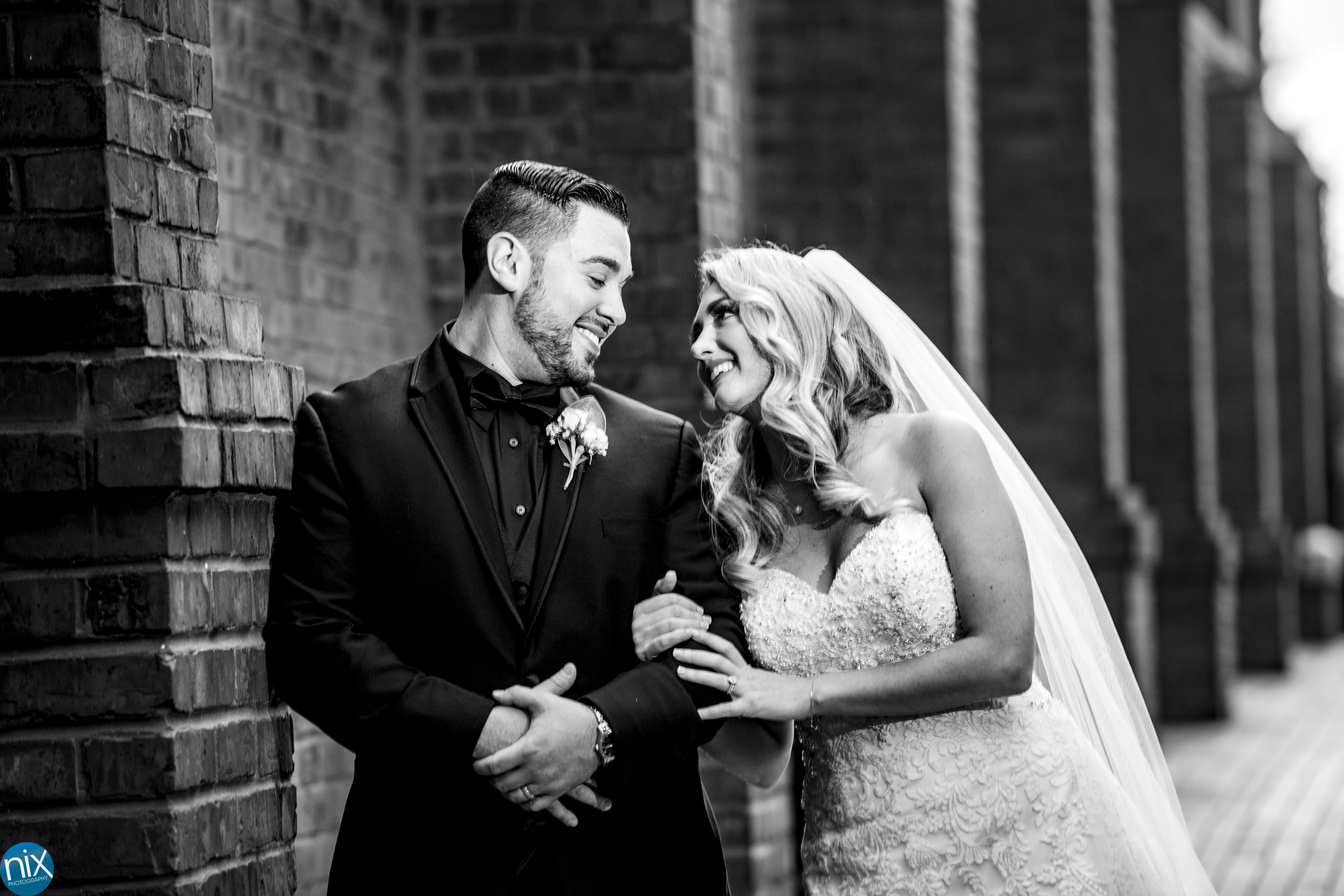 bride and groom at st peters catholic in charlotte black and white.jpg