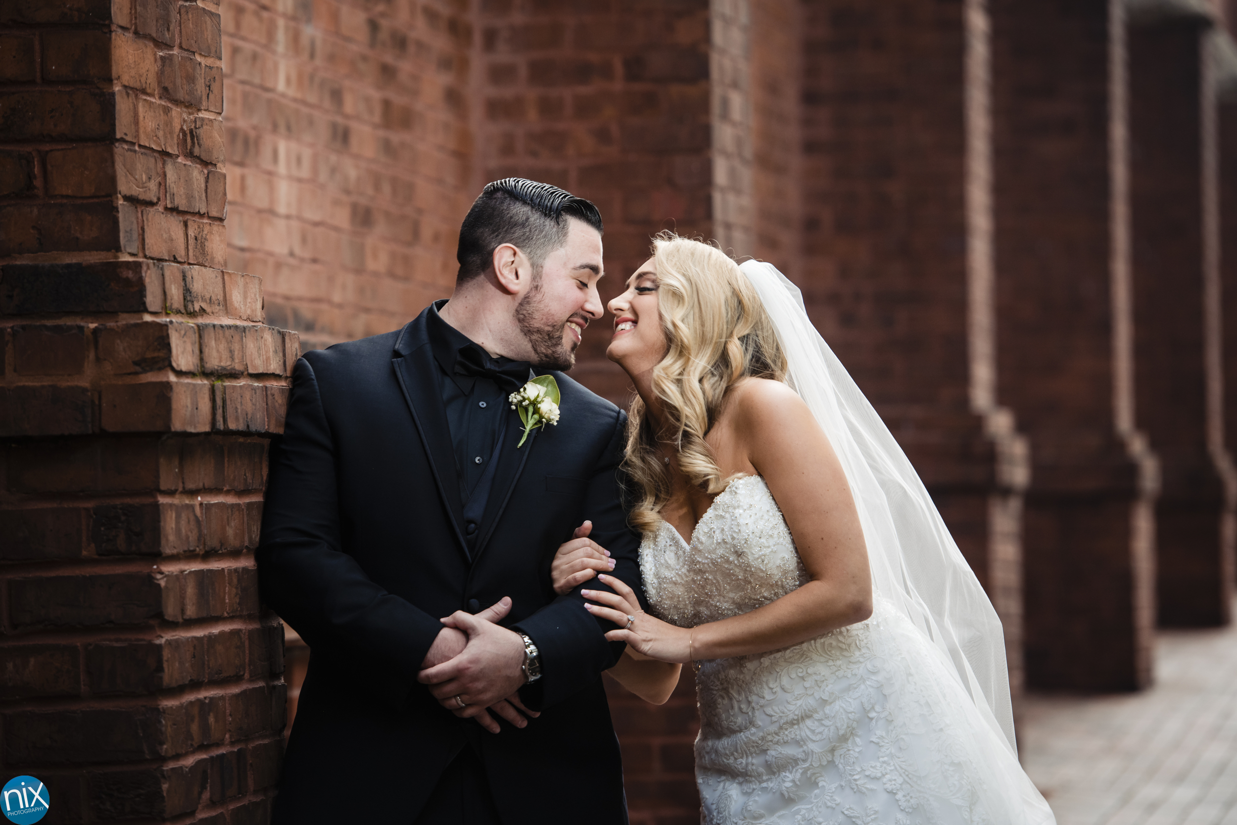 bride and groom at st peters catholic in charlotte color.jpg