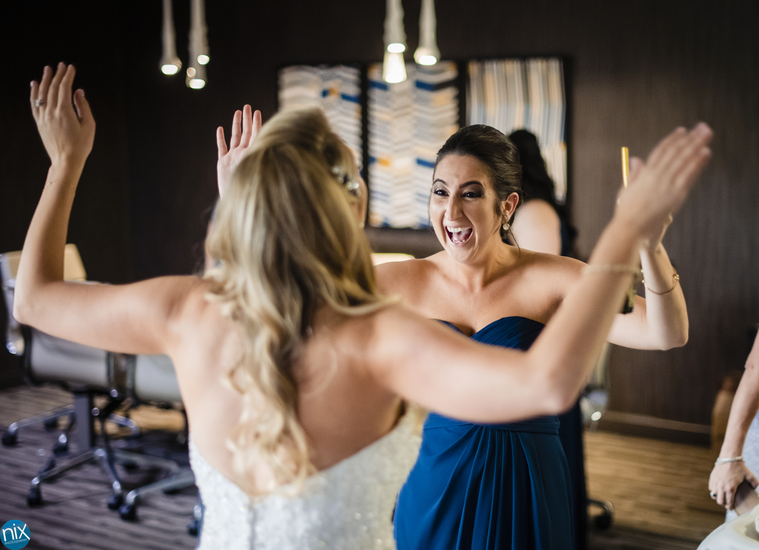 bridesmaide and bride at embassy suites in charlotte.jpg